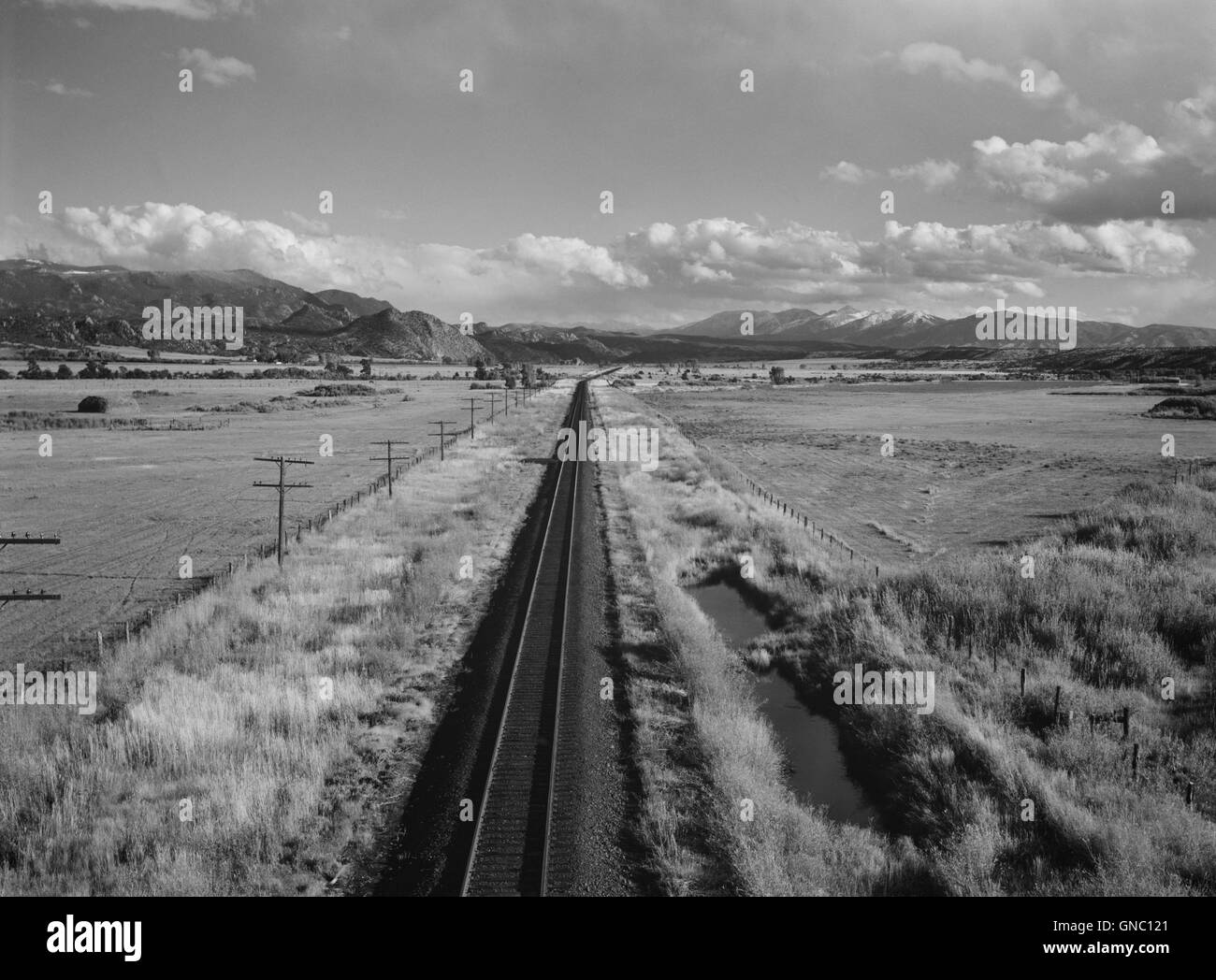 Railroad Tracks with Sawatch Mountains in Background, near Buena Vista, Colorado, Marion Post Wolcott for Farm Security - Stock Image