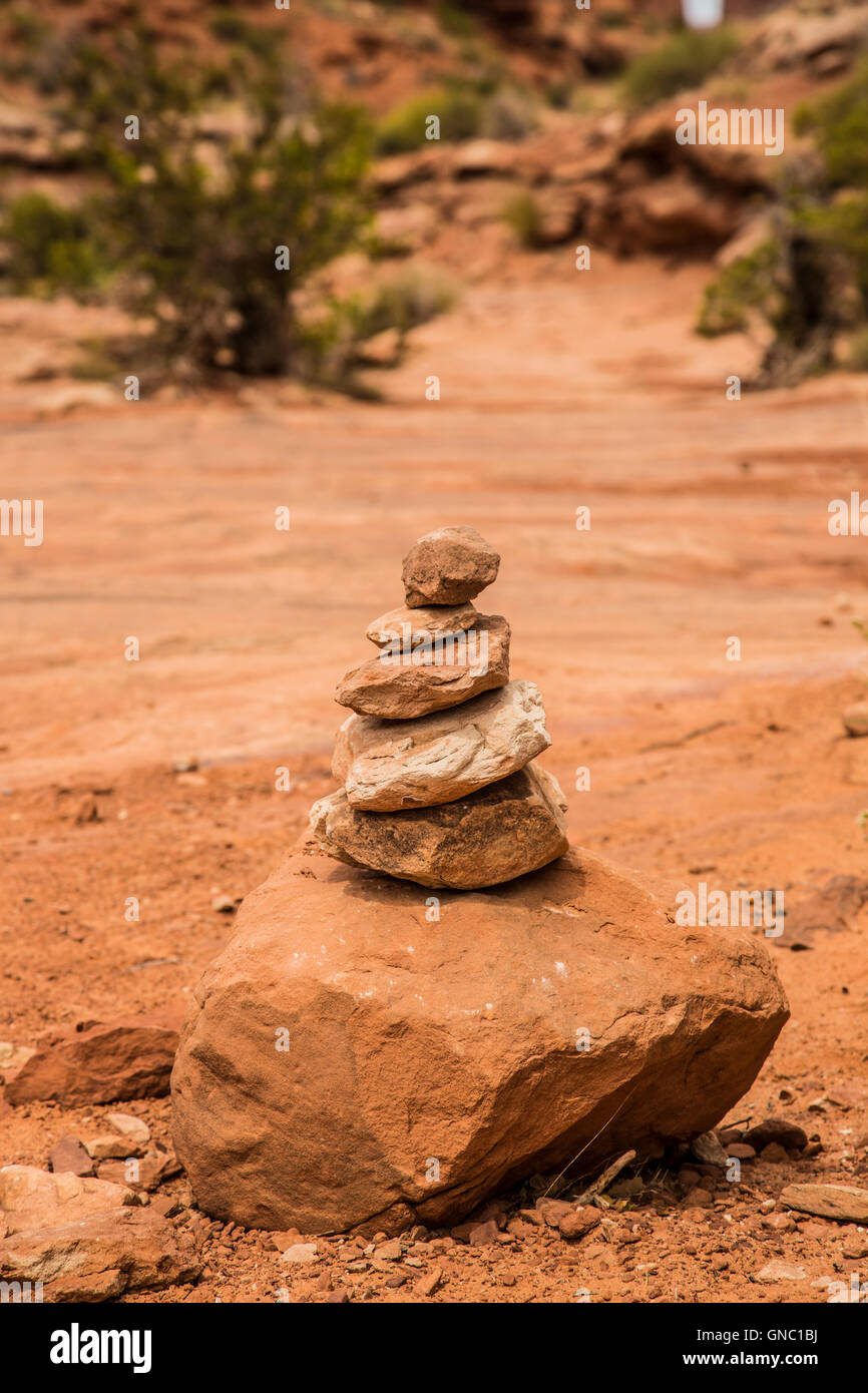A stone cairn on the Park Avenue Trail in Arches National Park USA - Stock Image