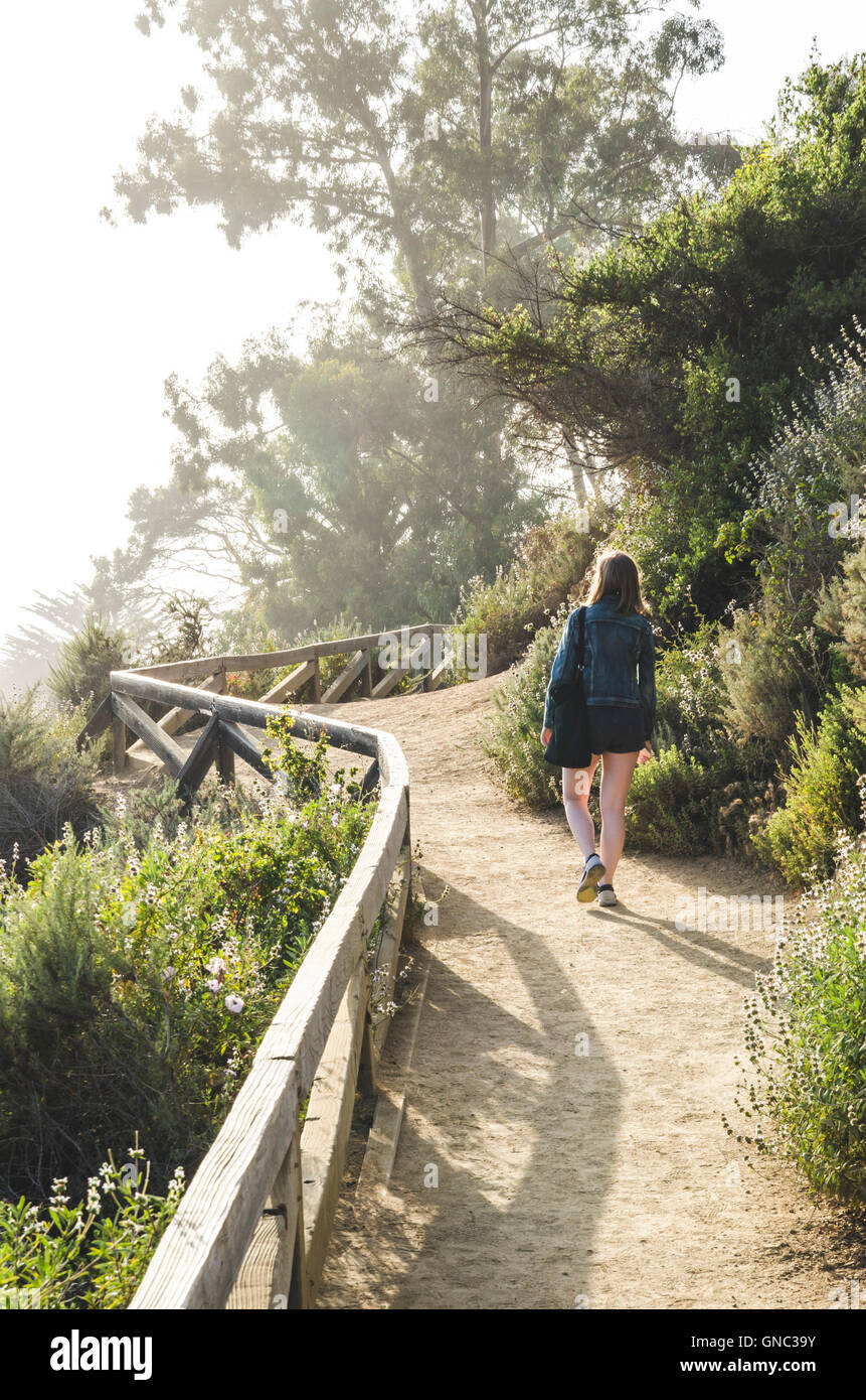 Young Woman Walking Along Path, McWay Cove, Big Sur, California, USA - Stock Image