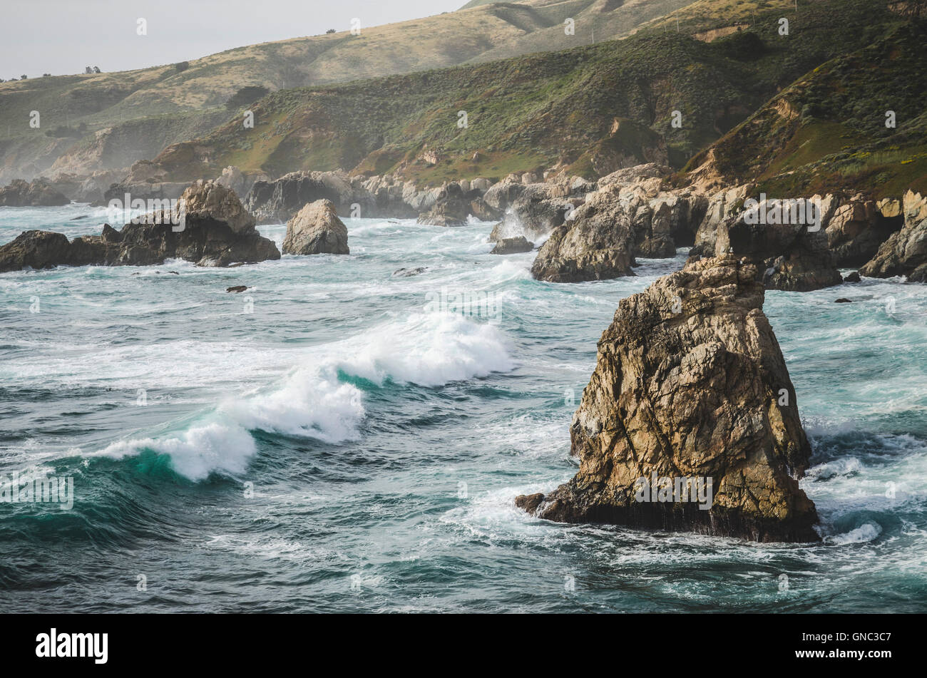 Jagged Rock Formations and Ocean Waves, Soberanes Point, Garrapata State Park, California, USA Stock Photo