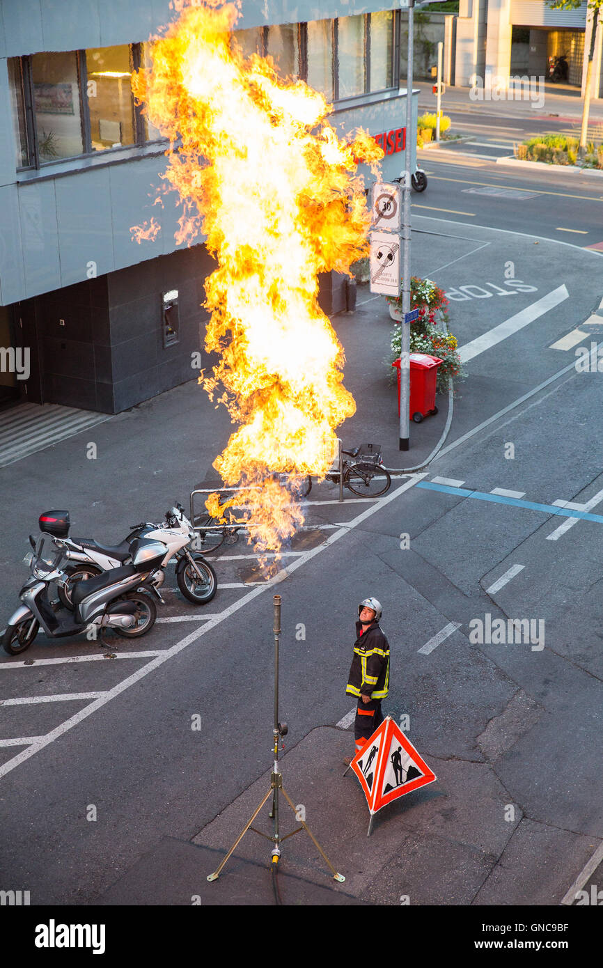 Geneva, Switzerland - August 24, 2016: Technician working on emptying a city gas pipeline through gas flaring. - Stock Image