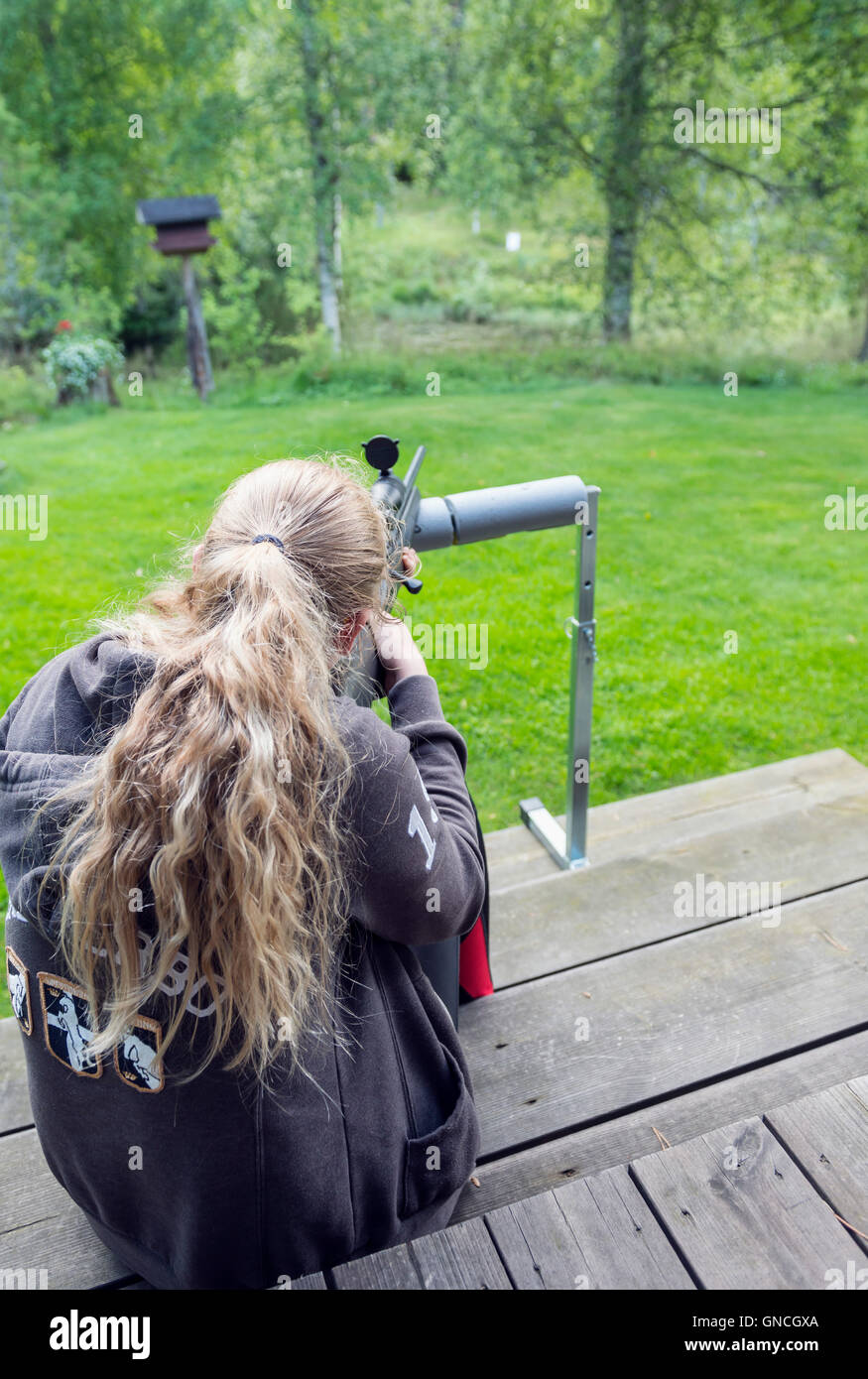 Girl aiming with rifle - Stock Image