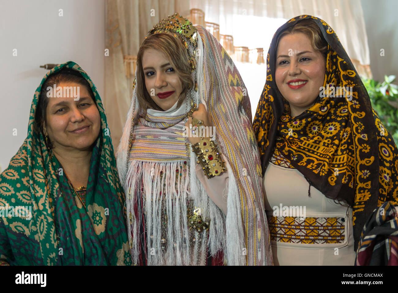 Bandar Torkaman, Turkmen Wedding, Bride With Traditional Veil & Relatives - Stock Image