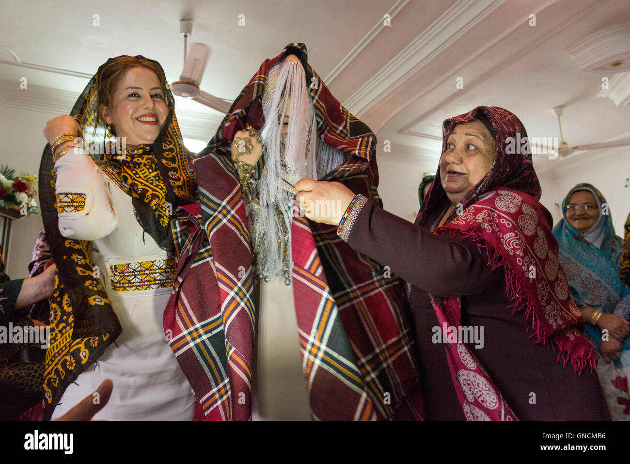 Bandar Torkaman, Turkmen Wedding, Bride Covered With Traditional Veil With Relatives In Ladies' Room - Stock Image
