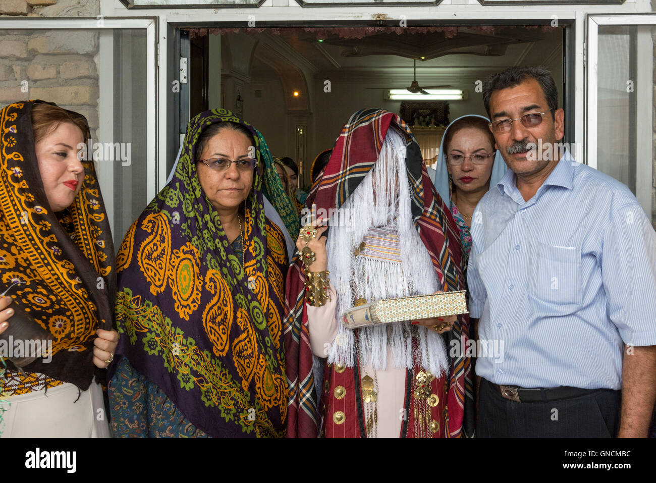 Bandar Torkaman, Turkmen Wedding, Bride Covered With Traditional Veil Exiting Lunch Venue - Stock Image