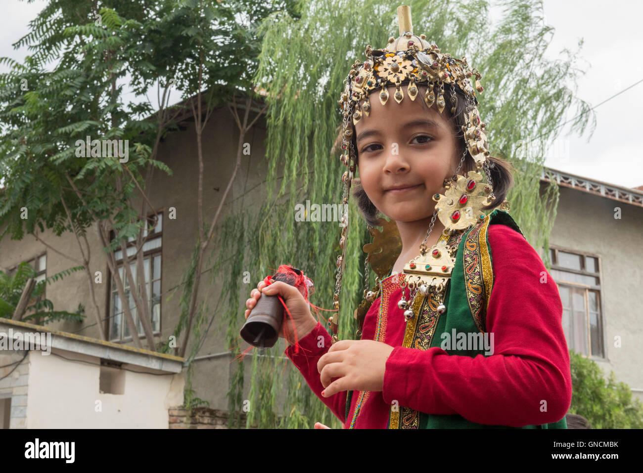 Bandar Torkaman, Turkmen Wedding, Girl Wearing Traditional Dress Outside Lunch Venue - Stock Image
