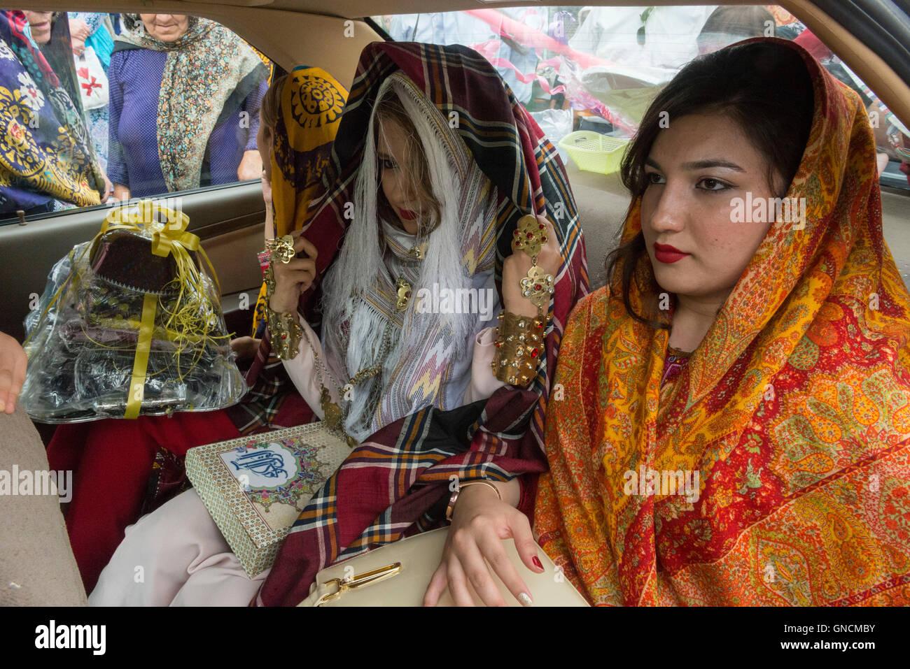 Bandar Torkaman, Turkmen Wedding, Bride Sitting With Female Relatives Inside Bridal Car - Stock Image