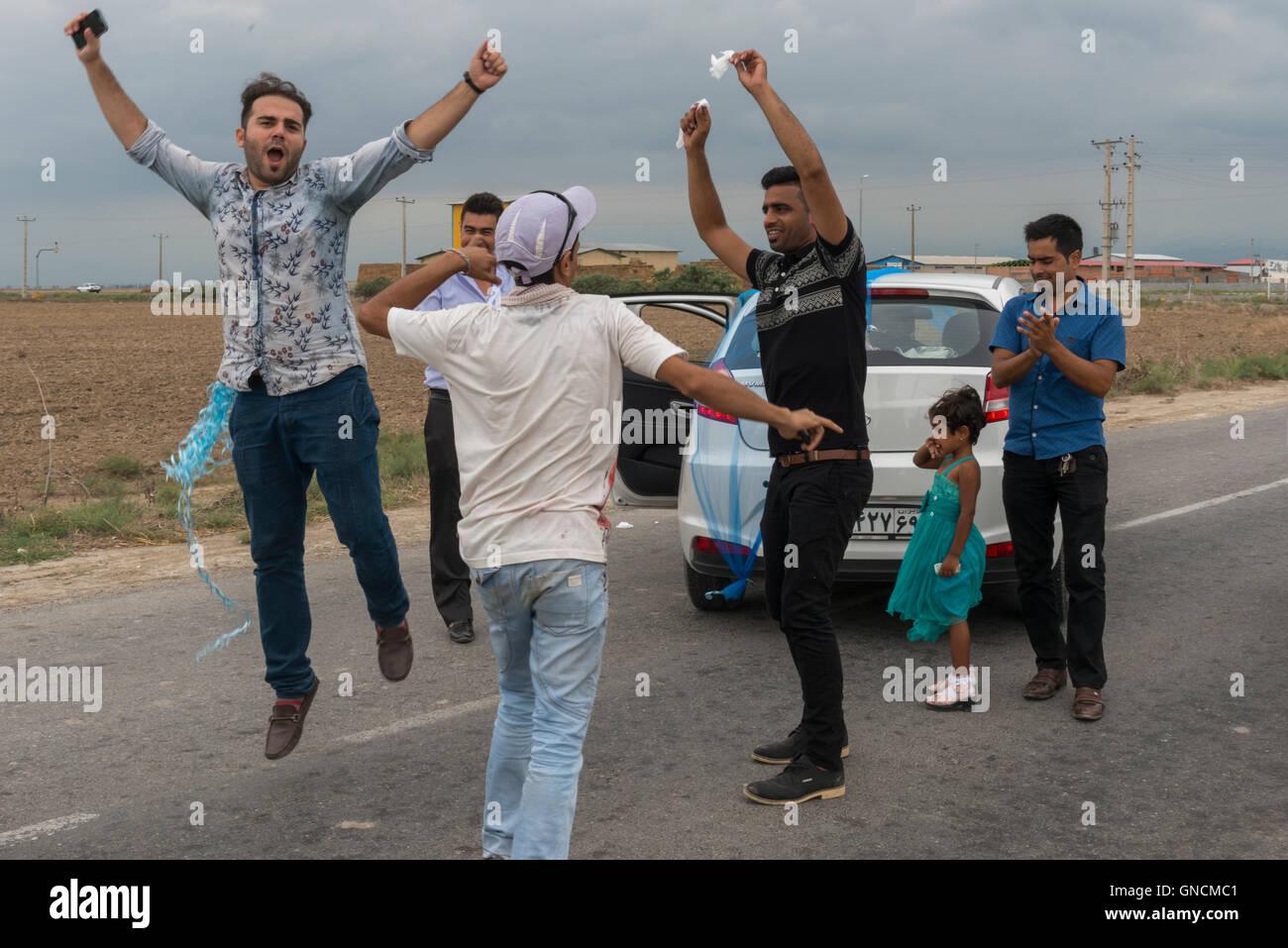 Bandar Torkaman, Turkmen Wedding, Male Guests Dancing On The Road - Stock Image