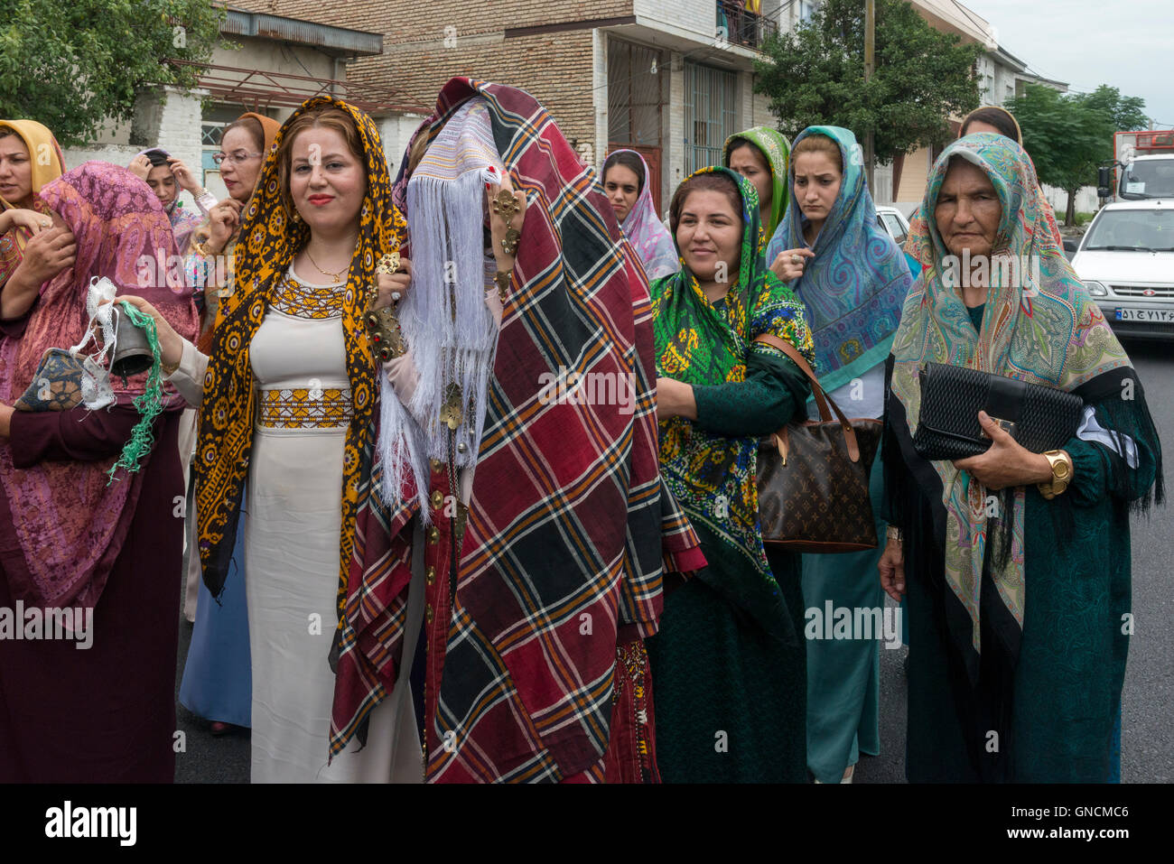 Bandar Torkaman, Turkmen Wedding, Bride Covered With Tratitional Veil Walking On The Street With Female Relatives - Stock Image