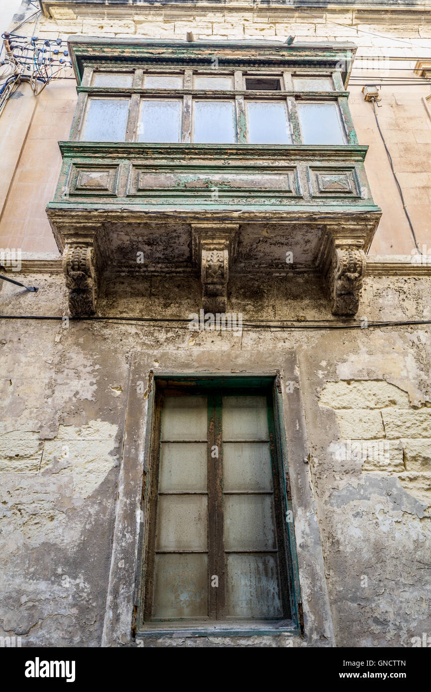 worn paint on window box and old building - Stock Image