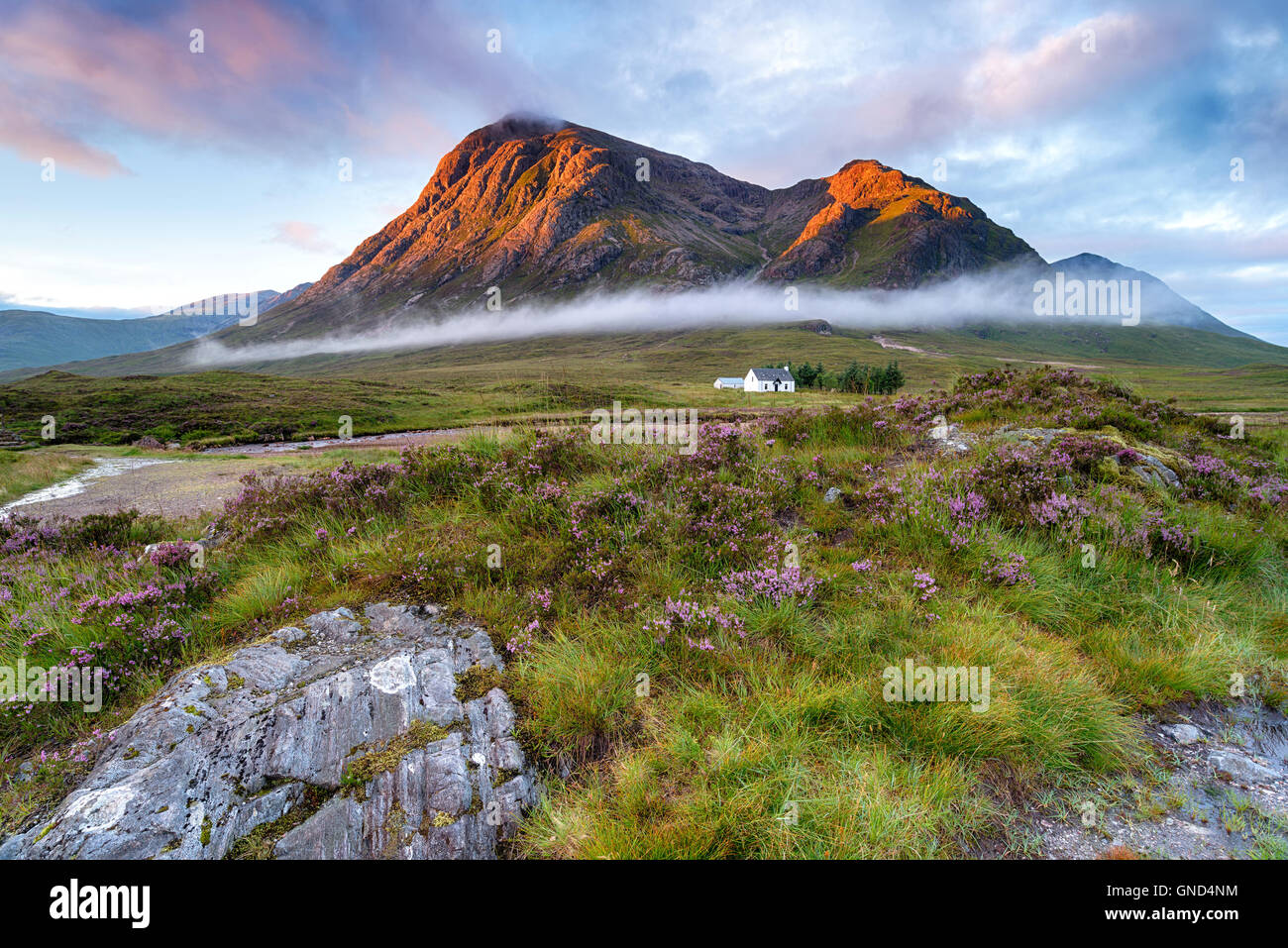 Sunrise over the mountain tops at Glencoe in the highlands of Scotland - Stock Image