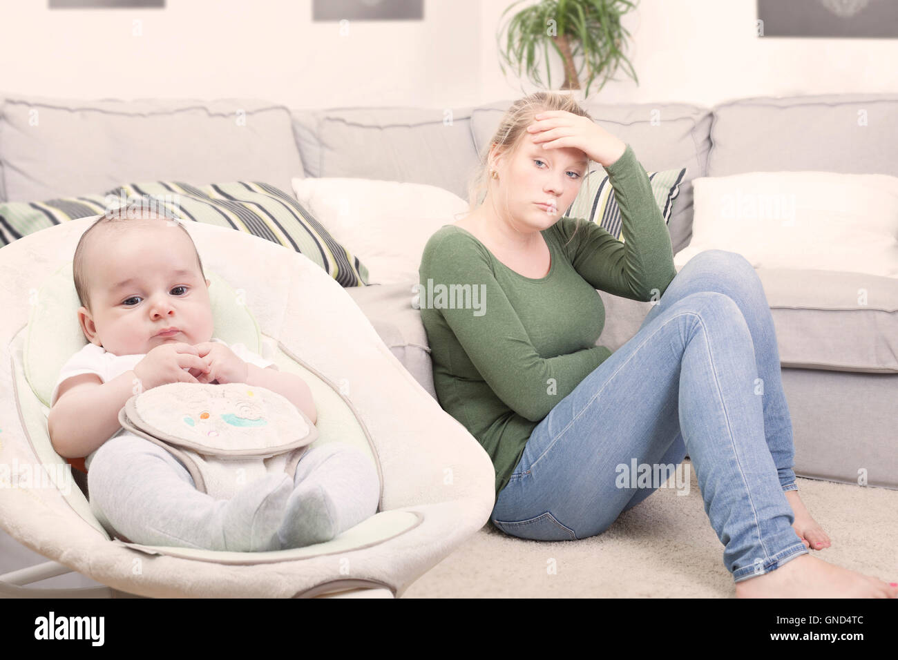 Young new mother suffering from postpartum depression - Stock Image