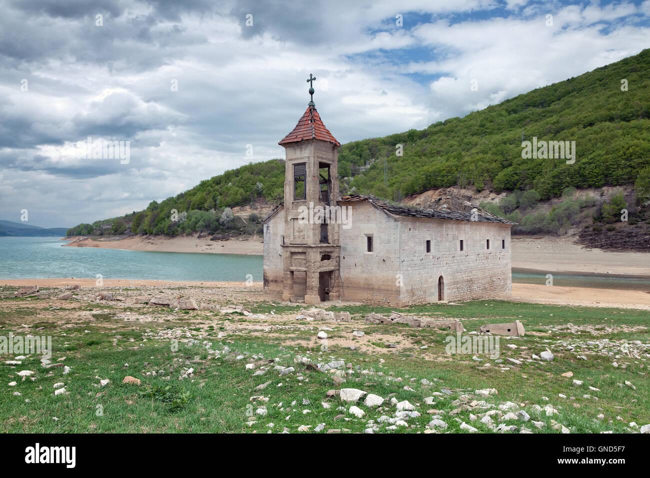 Old ruined church by the Mavrovo Lake, Macedonia - Stock Image