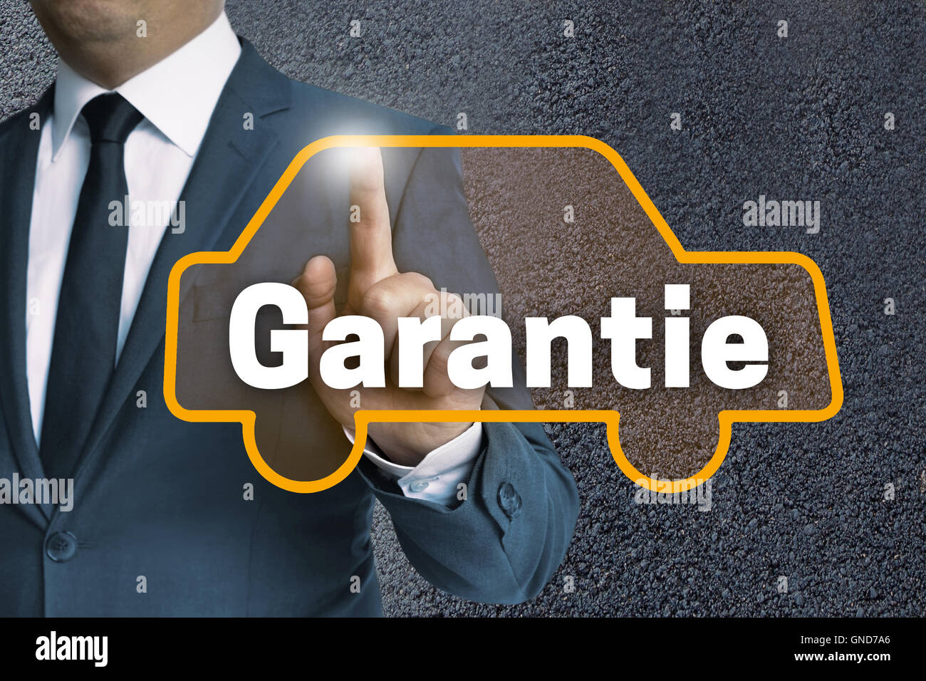 garantie (in german warranty) auto touchscreen is operated by businessman concept. Stock Photo