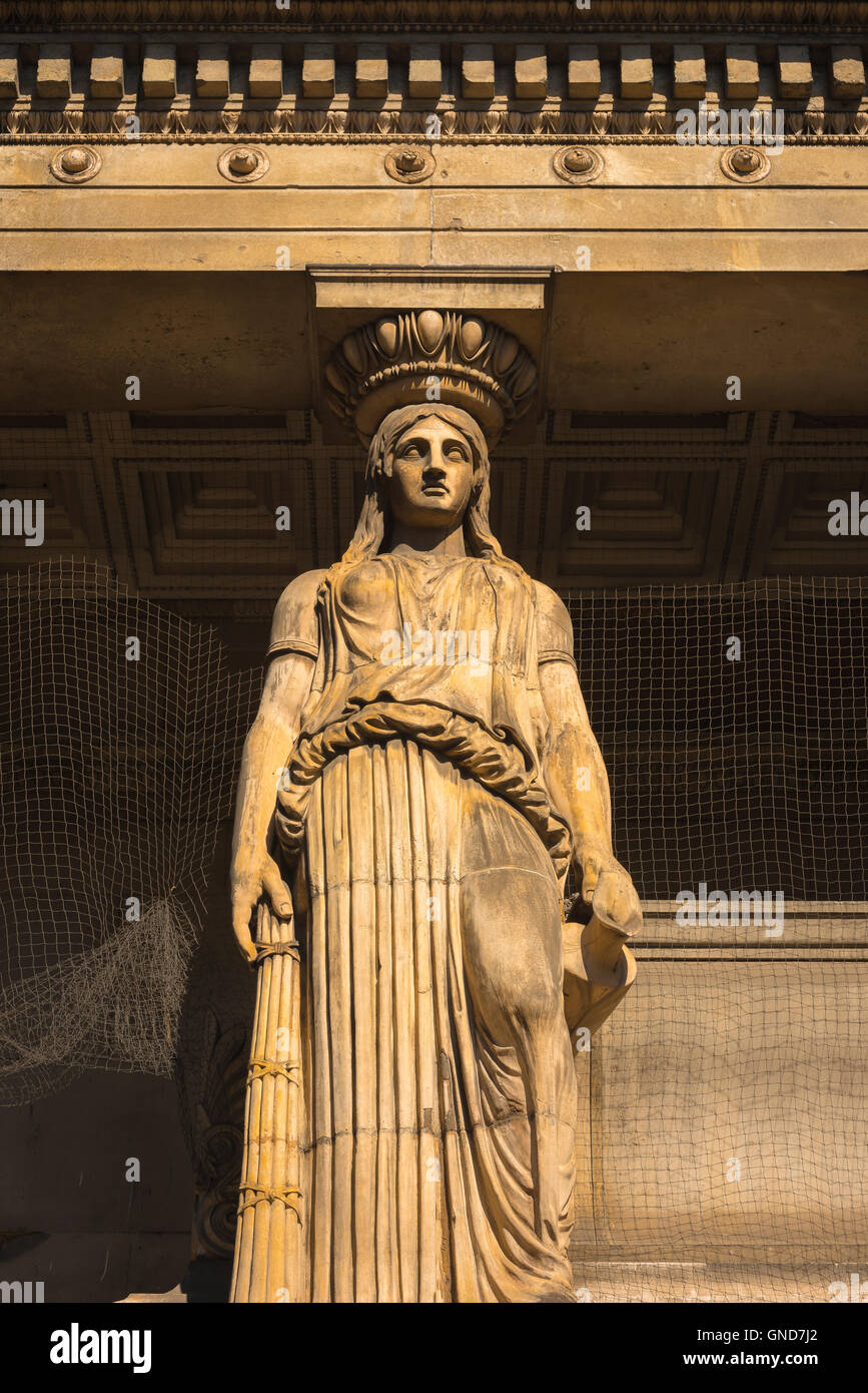 A terracotta caryatid above the crypt of the Victorian Greek Revival style St Pancras New Church in the Euston Road, - Stock Image