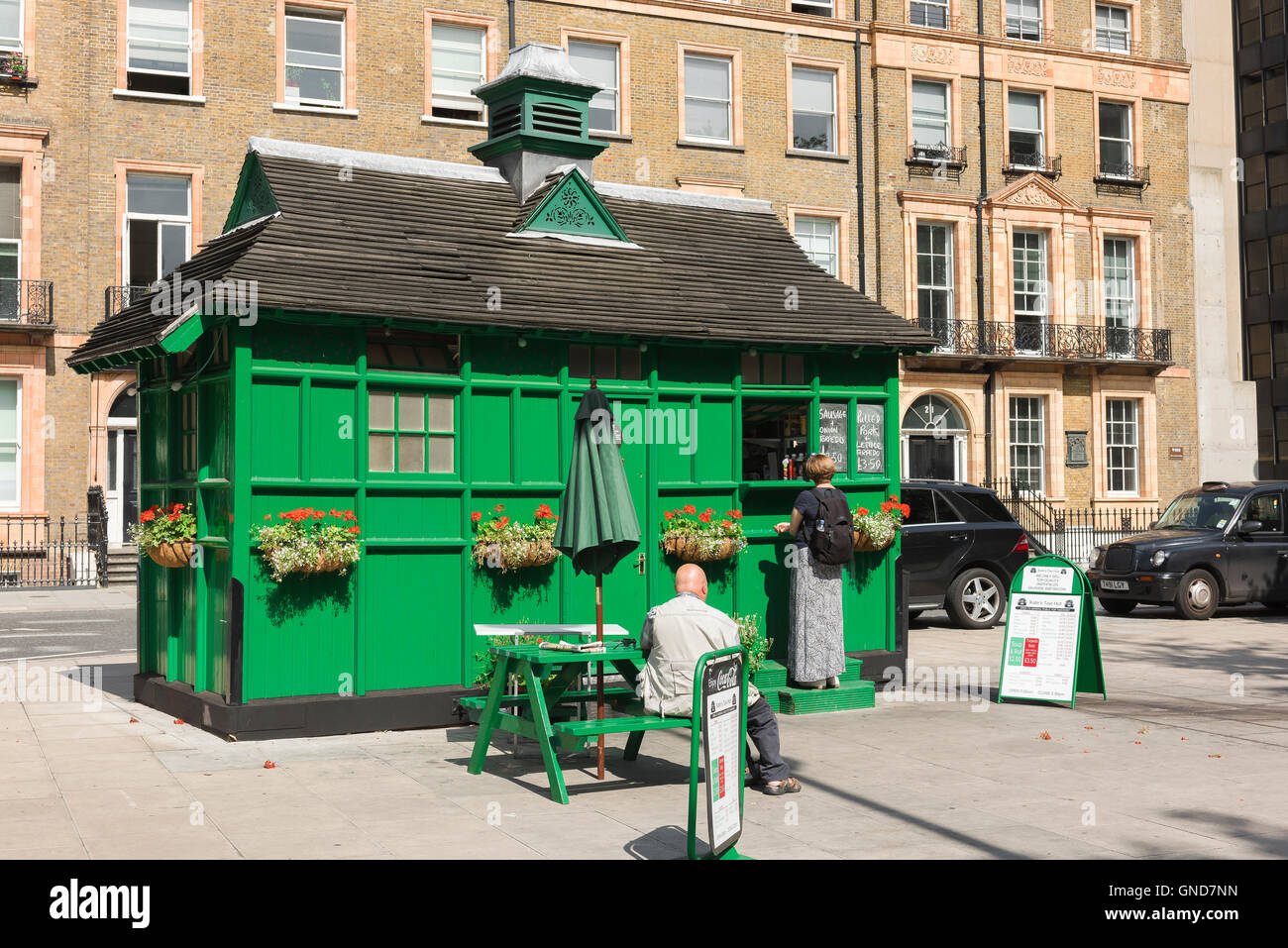 Cabmens shelter, people buy food from a converted nineteenth century cabman's shelter in Russell Square, Bloomsbury, - Stock Image