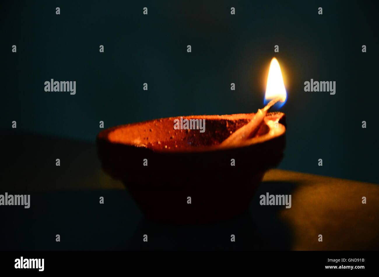 An earthen lamp. - Stock Image
