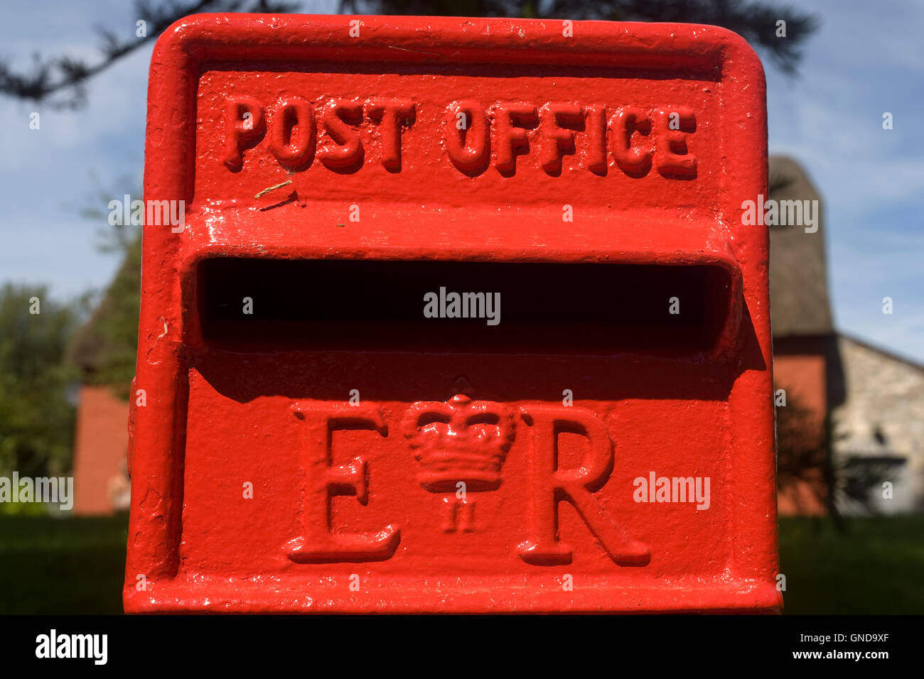 Red Post Office posting box in the village of Merthyr Mawr Stock Photo