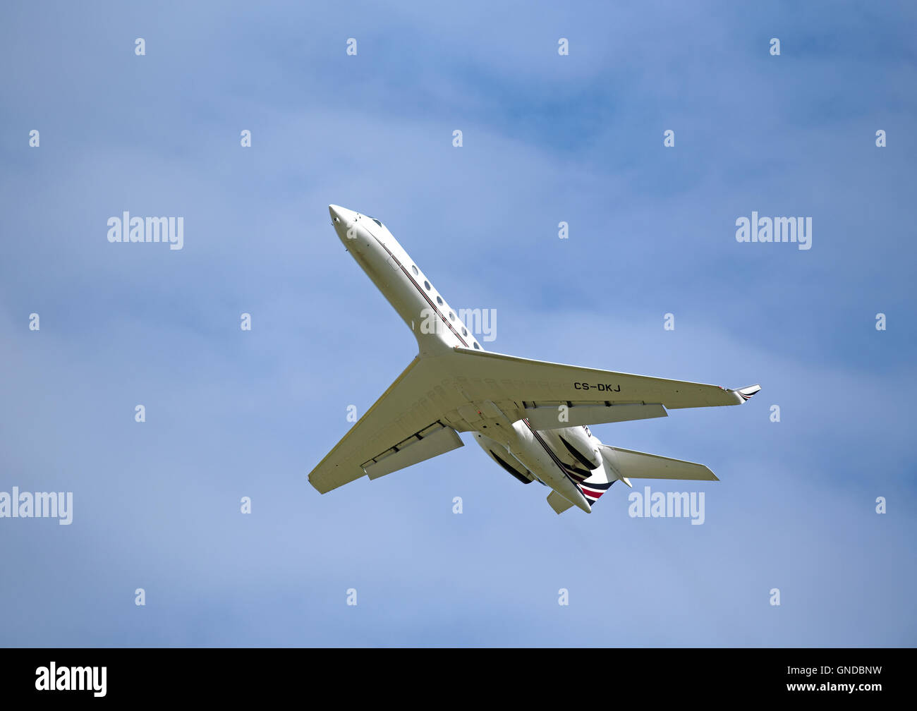 A twin engined Gulfstream G550 climbs out from Inverness airfield in Scotland UK.  SCO 11,216. - Stock Image
