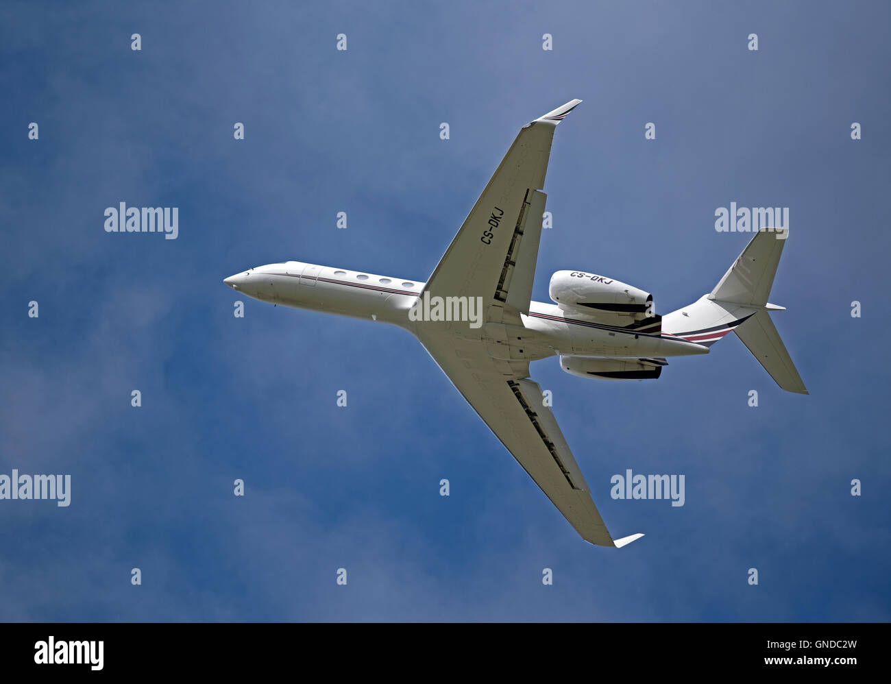 A Gulfstream G550 departs Inverness airfield in Scotland UK.  SCO 11,216. Stock Photo