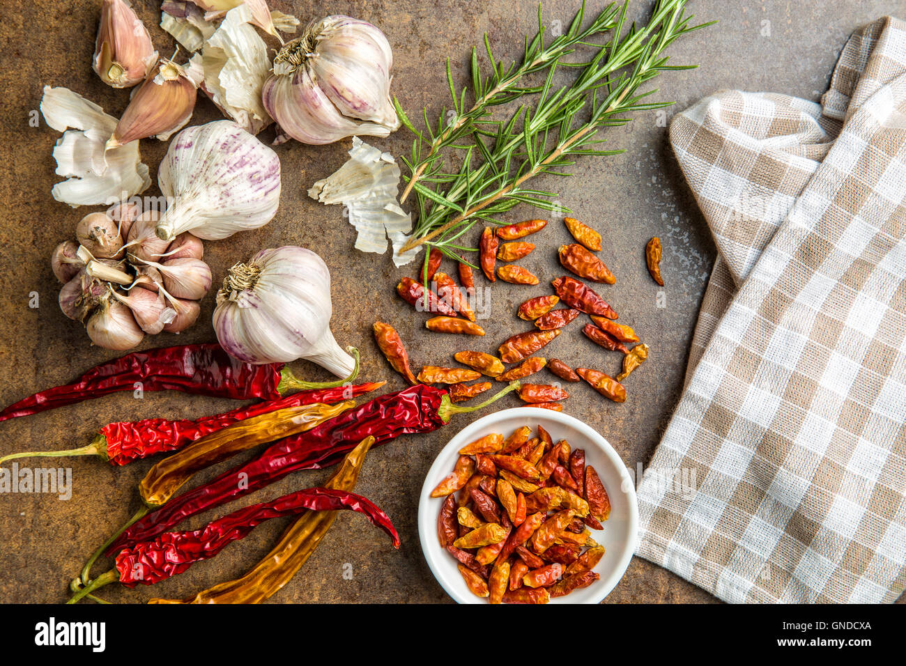 Garlic, chili peppers and rosemary. Top view. Stock Photo