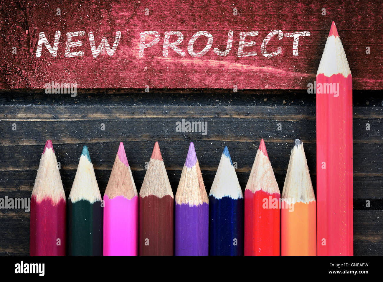 New Project text and group of pencil on wooden table - Stock Image