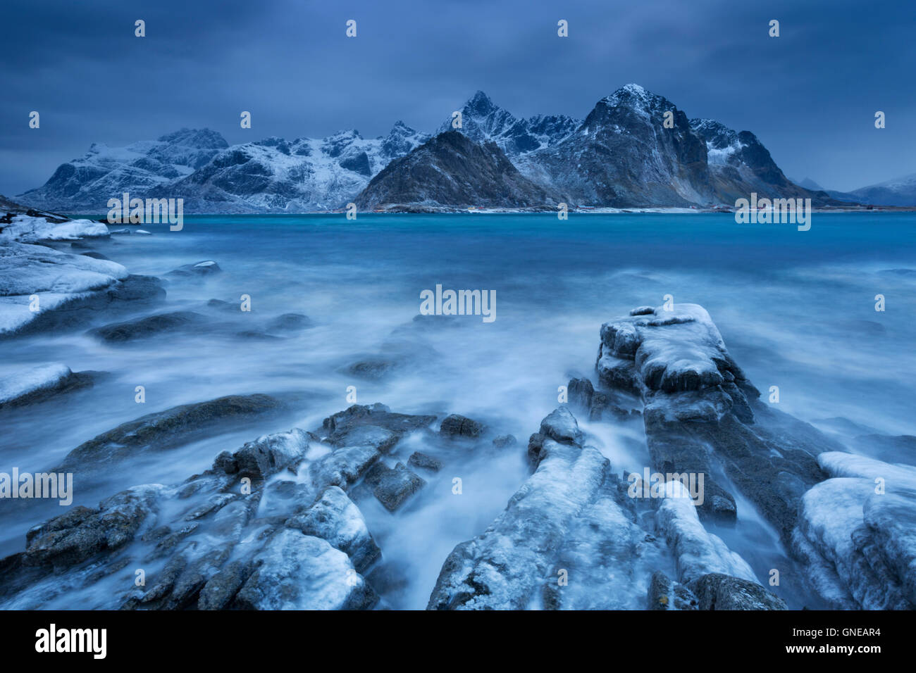 Dark clouds over a fjord near Vareid on the Lofoten in northern Norway on a cold day in winter. - Stock Image