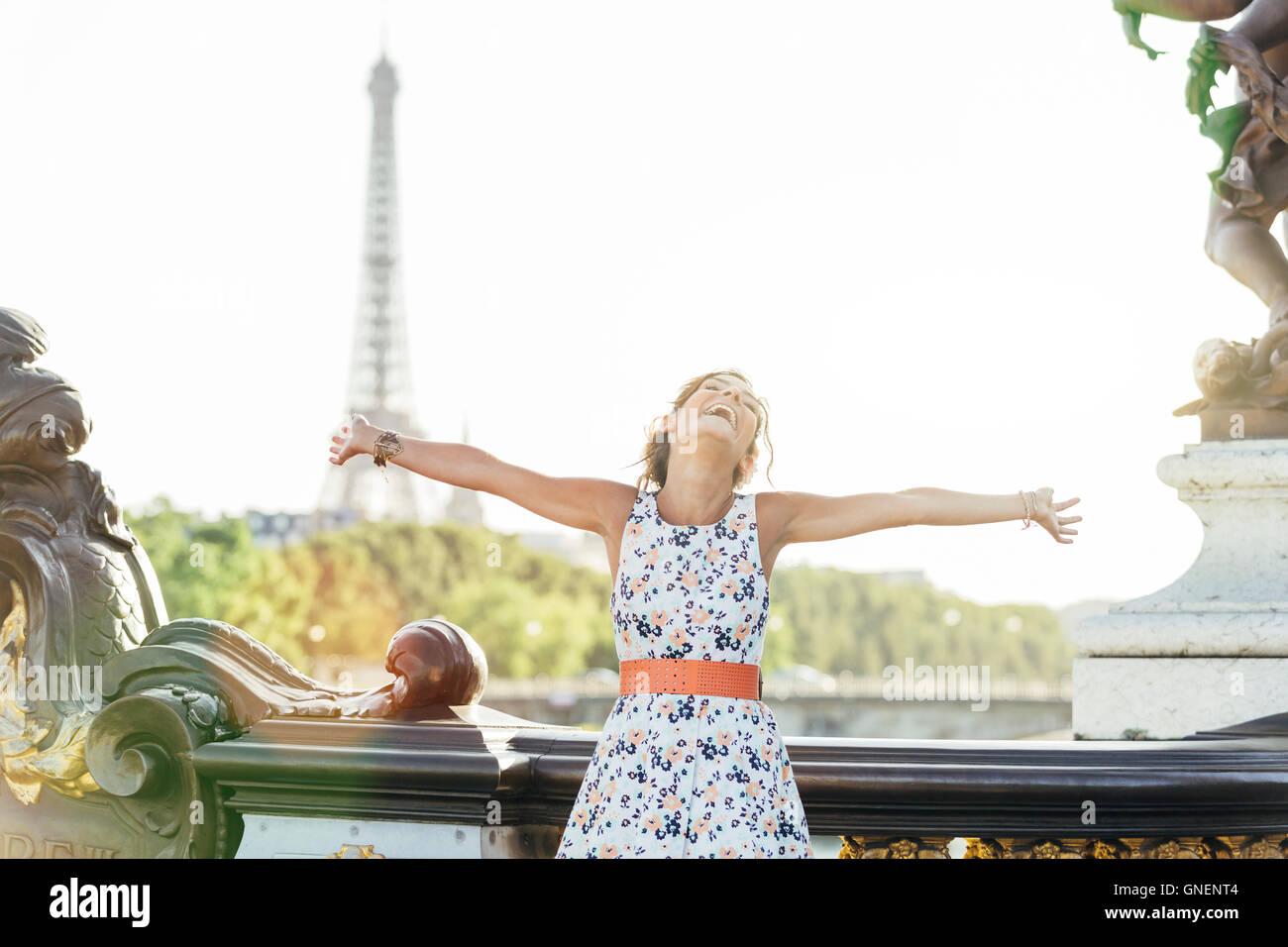 Happy woman visiting Paris - Stock Image