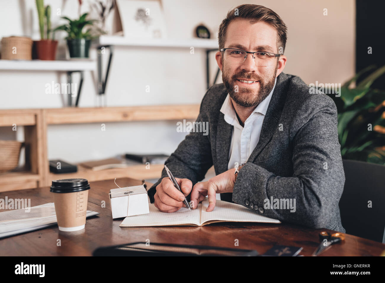 Growing a small business with smile - Stock Image