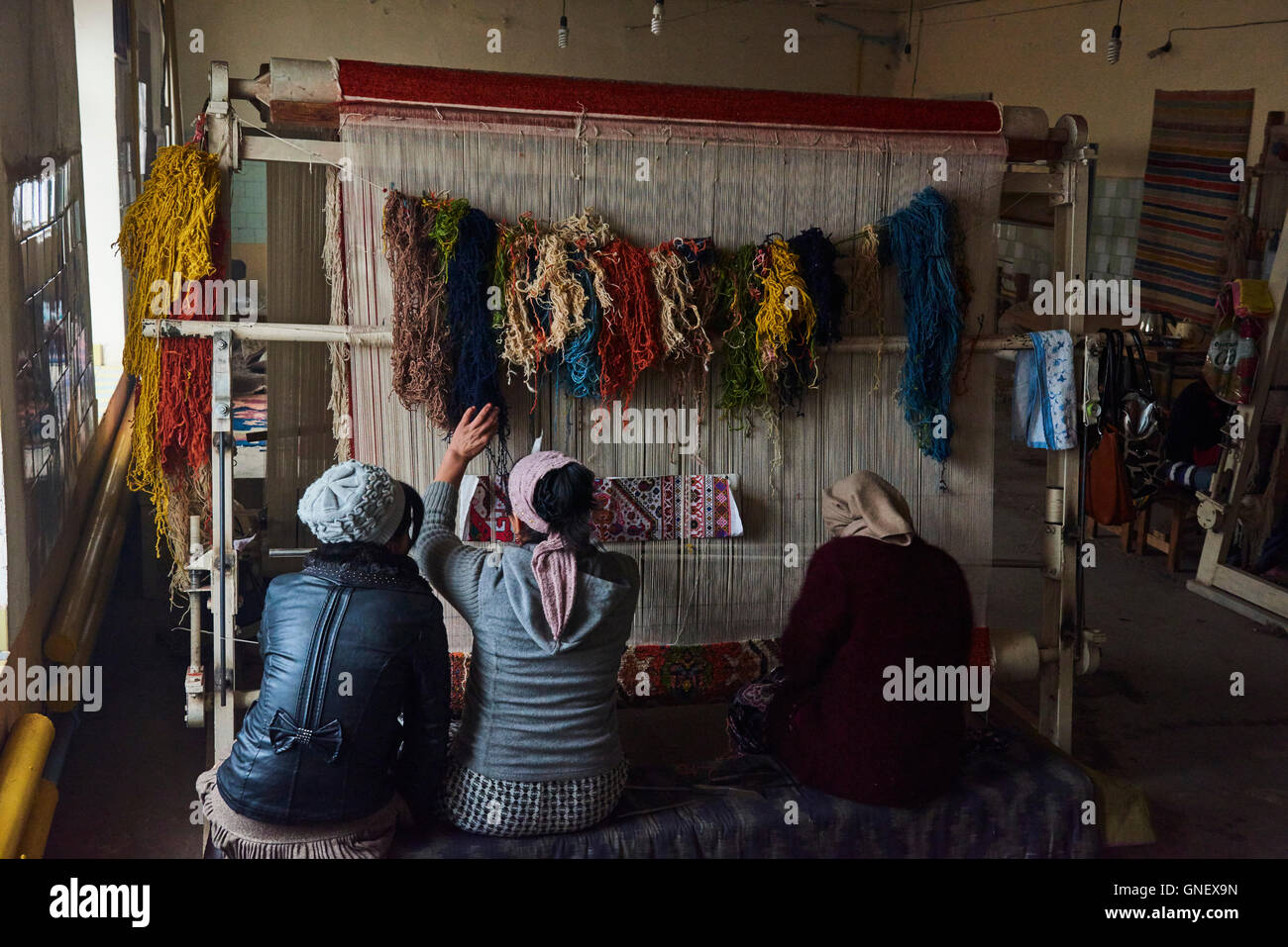 Uzbekistan, Fergana region, Marguilan, wool carpet workshop Stock Photo