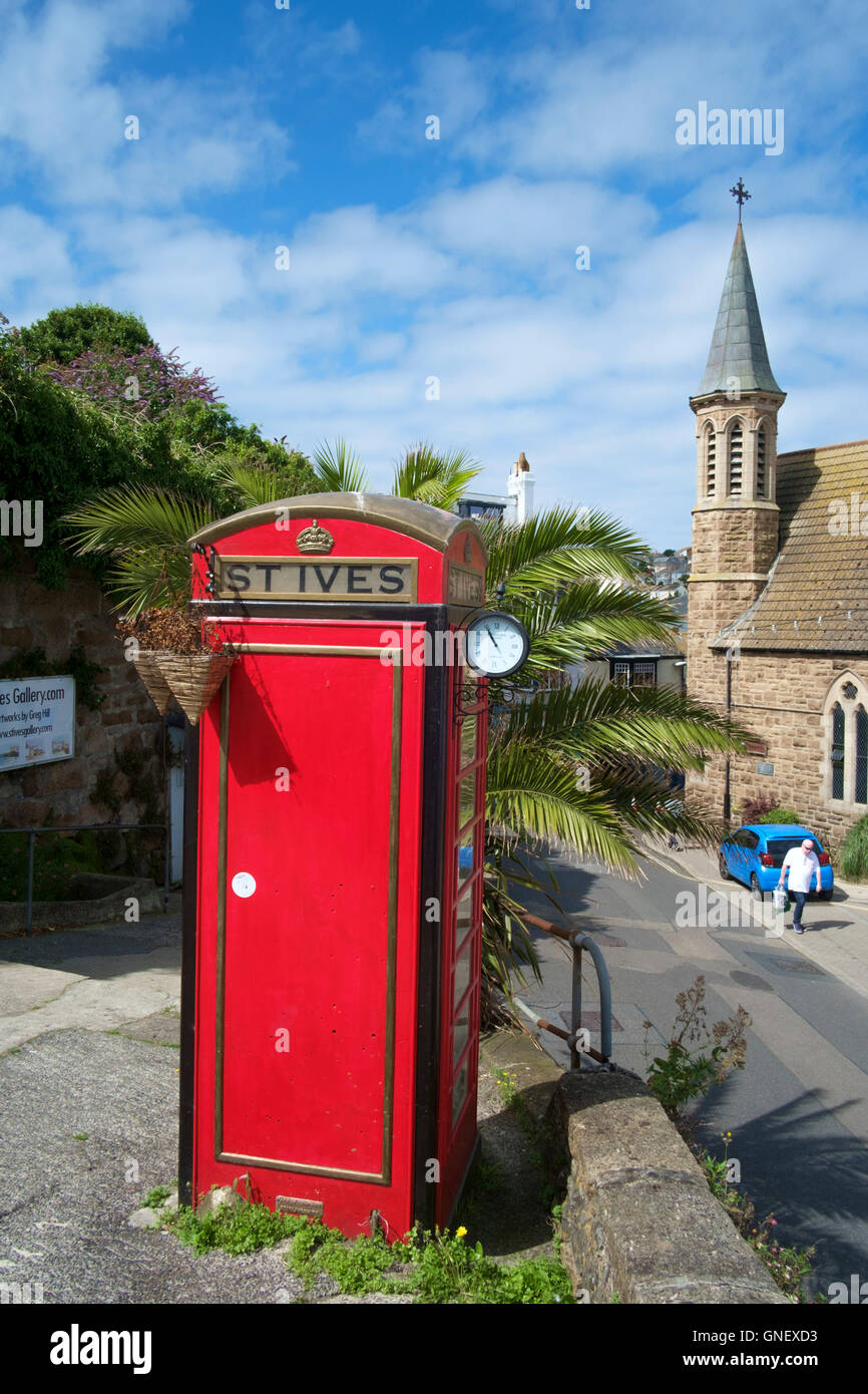 St Ives a seaside town in Cornwall England UK Red Telephone Box booth - Stock Image