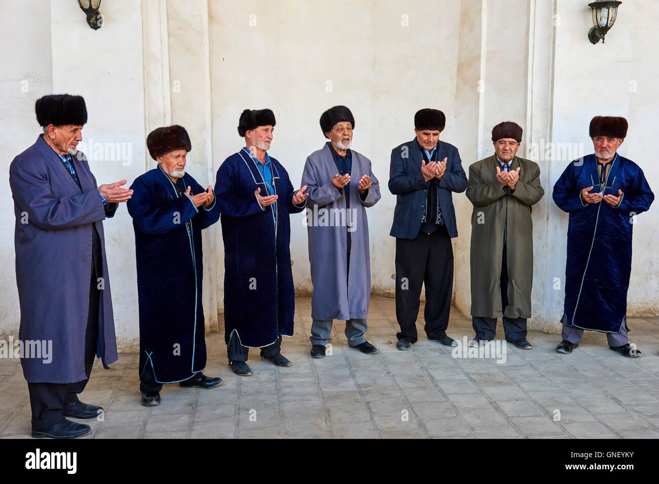 Uzbekistan, Bukhara, Unesco world heritage, prayer in the mosque - Stock Image