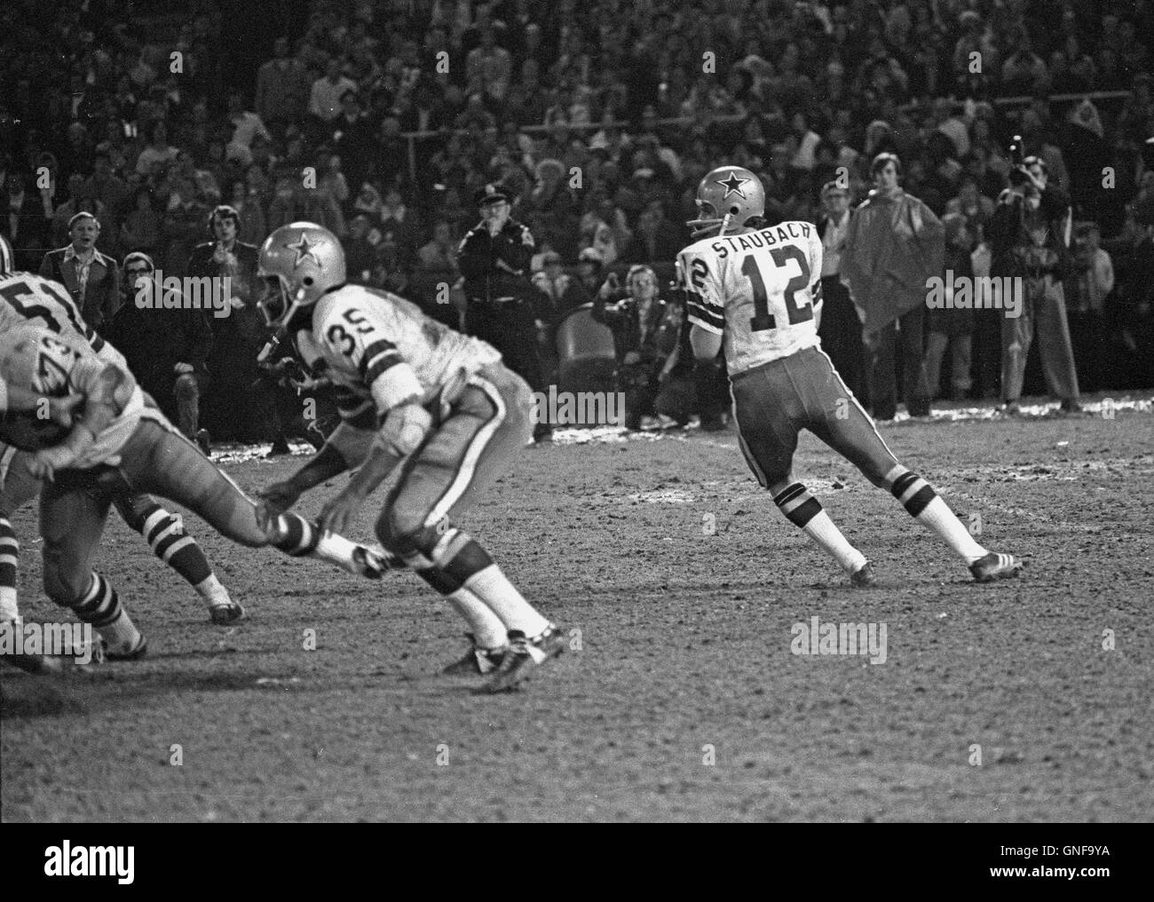 ffc252ba232 Dallas Cowboys quarterback Roger Staubach (12) looks for a received during  the NFC Championship game against the Washington Redskins at RFK Stadium in  ...