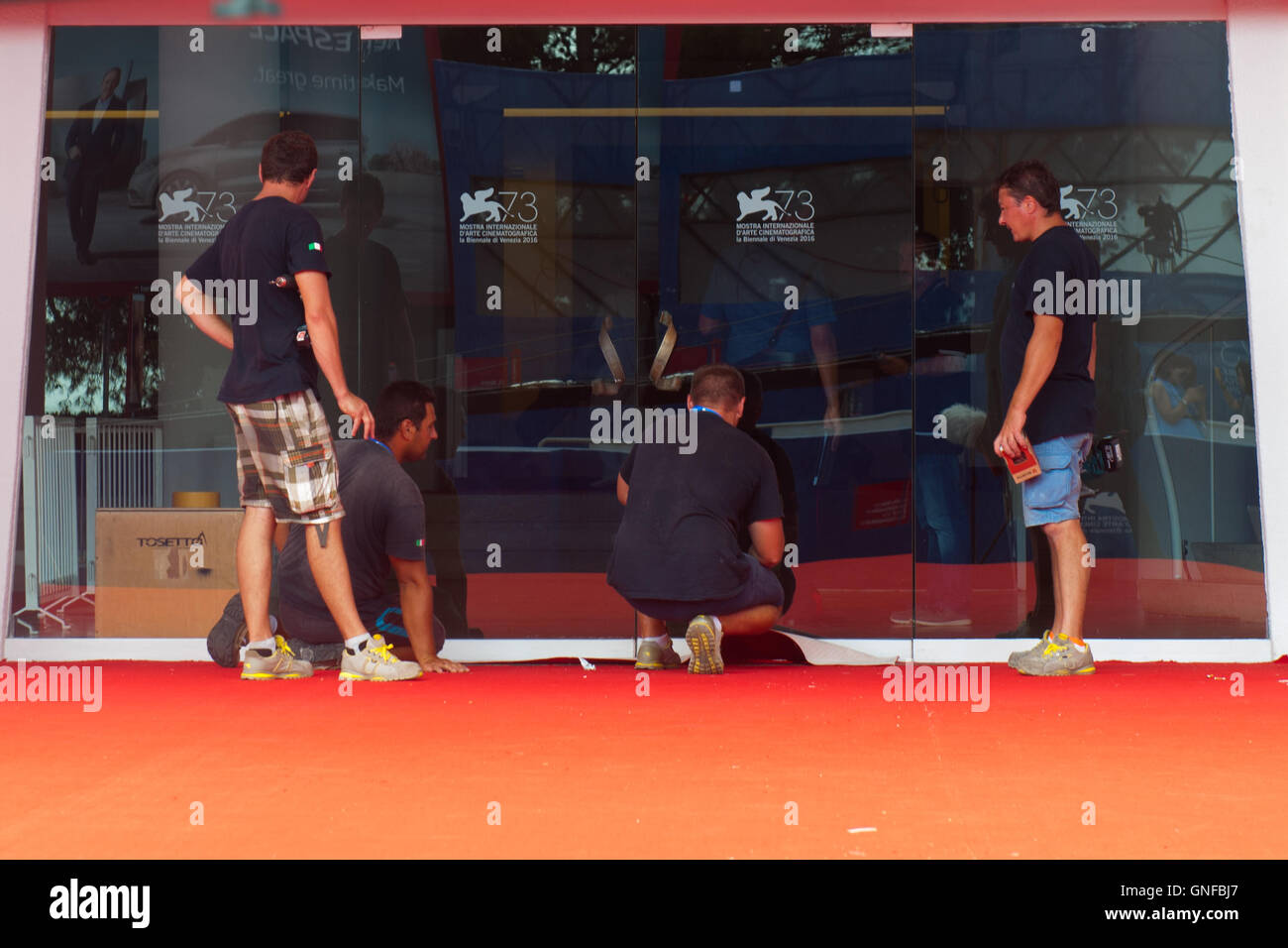 Venice, Italy. 30th August, 2016. Workers finish to prepare the area of the red carpet of the 73rd Venice Film Festival. - Stock Image