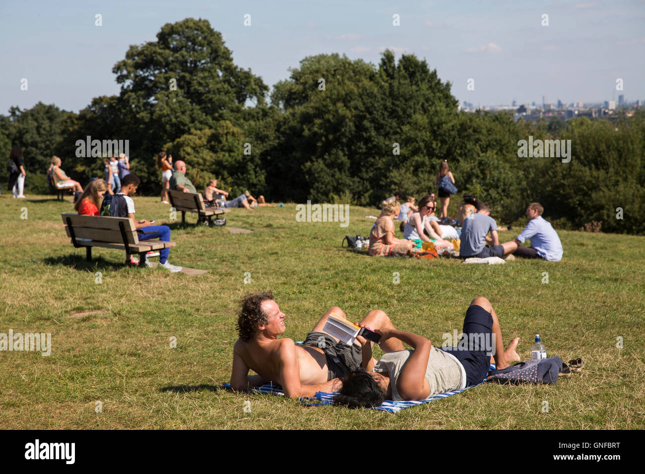 London, UK. 30th Aug, 2016. UK Weather: People enjoy in the sun on Hampstead Heath during hot summer day in London. - Stock Image
