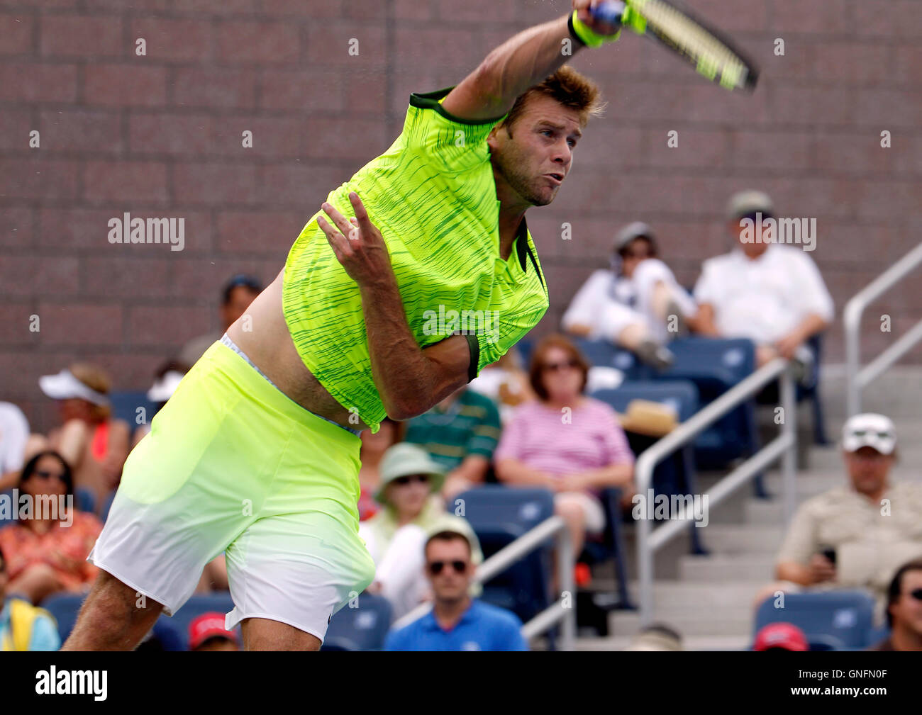 New York, United States. 31st Aug, 2016. Ryan Harrison of the United States serves to fifth seeded, Milos Raonic - Stock Image