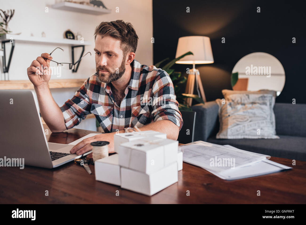 Putting in the hours to build his small business - Stock Image