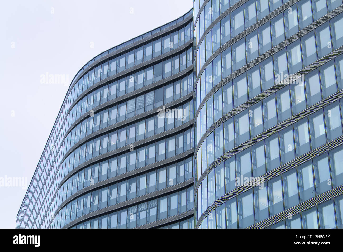 Detail of the modern architecture, with its curves and lines. Blue and grey tones. - Stock Image