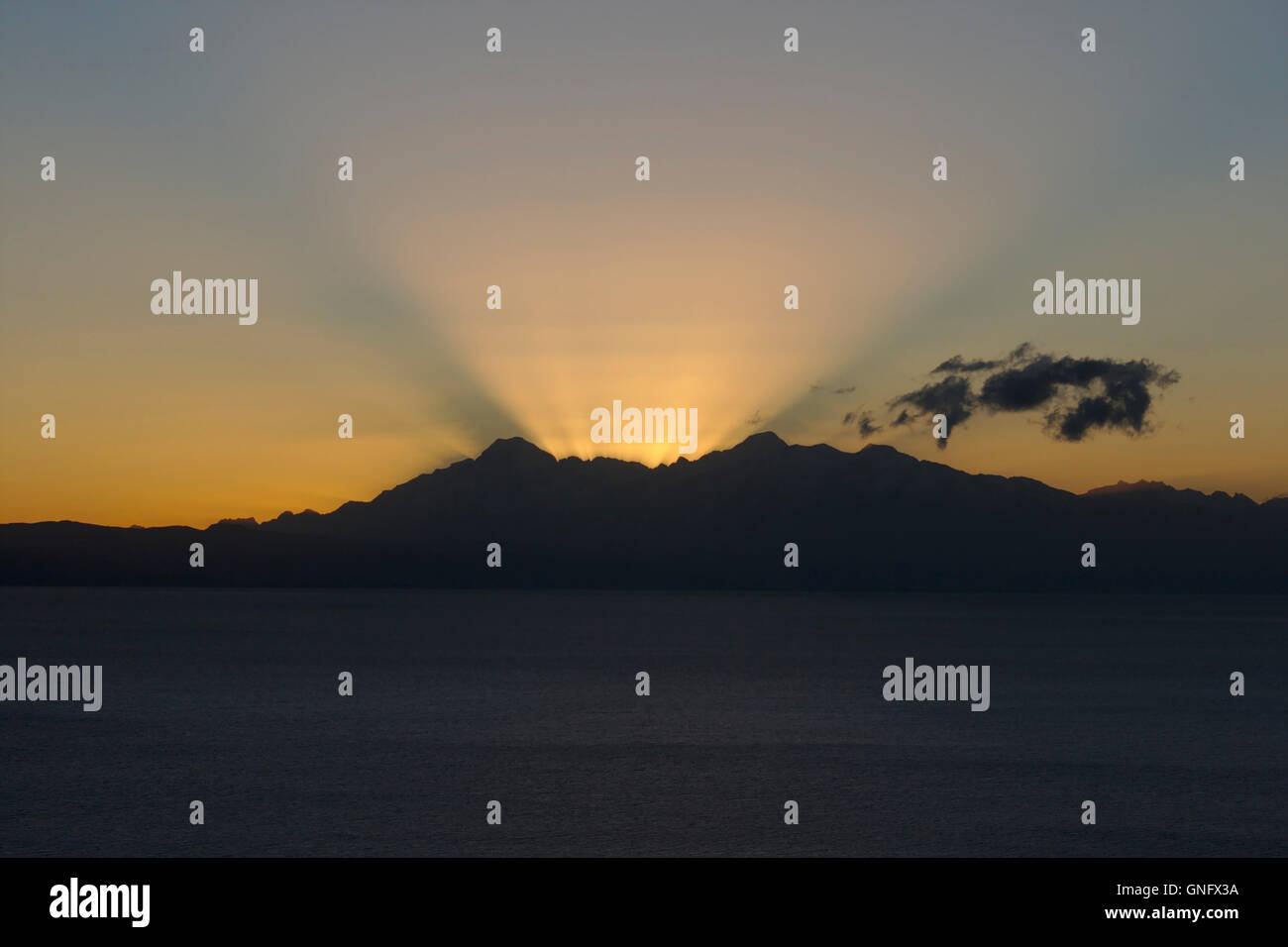 Sunrise behind the Cordillera Real with Illampu and  Ancohuma. Isla del Sol, Lake Titicaca, Bolivia - Stock Image