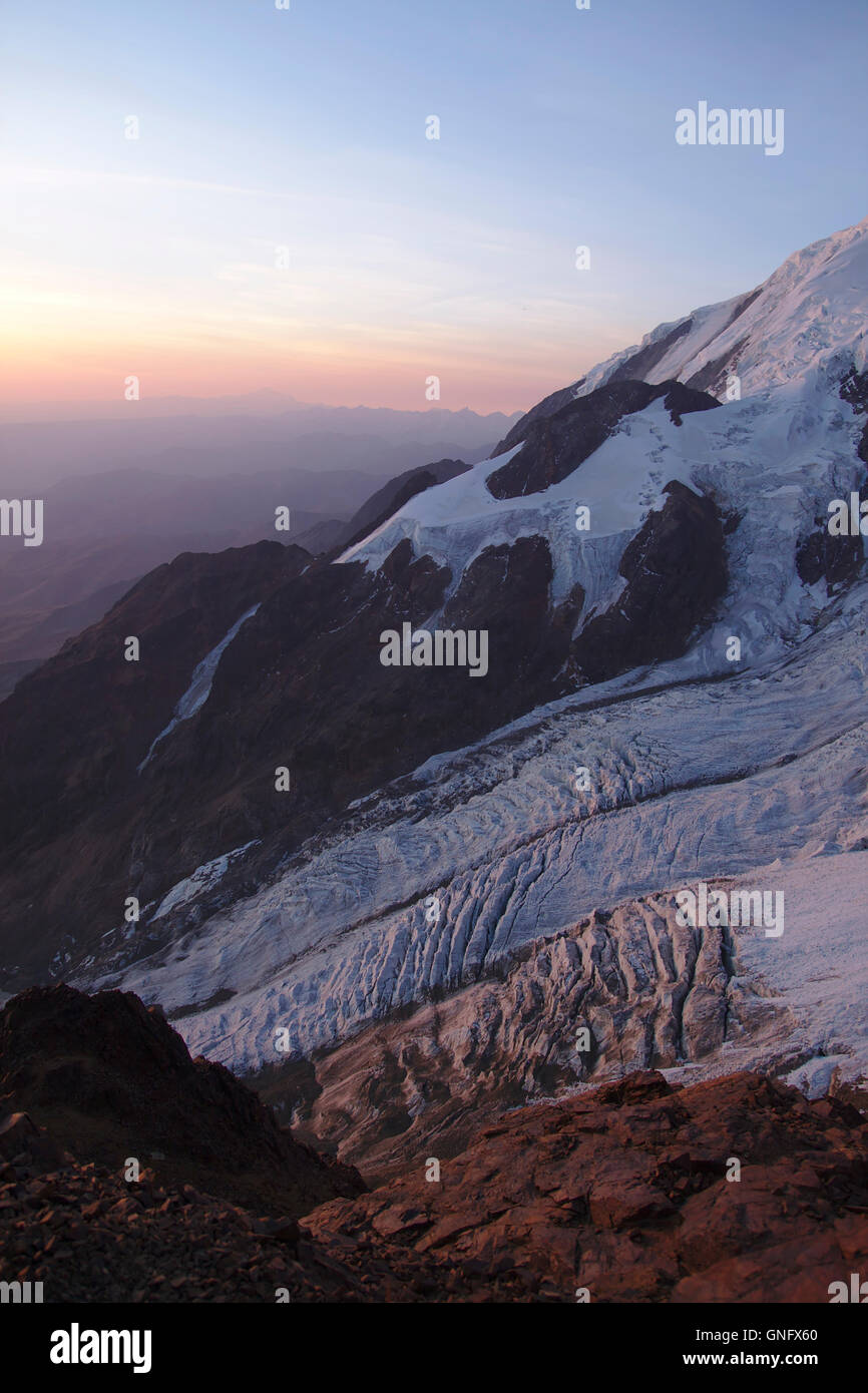 Glaciers on Illimani seen from High Camp, sunset, Bolivia - Stock Image