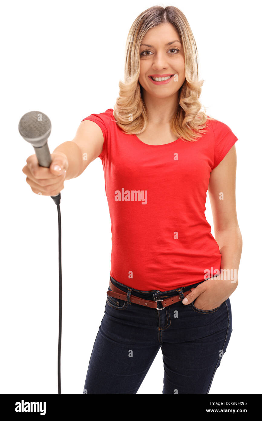 Young woman holding a microphone and doing an interview isolated on white background Stock Photo