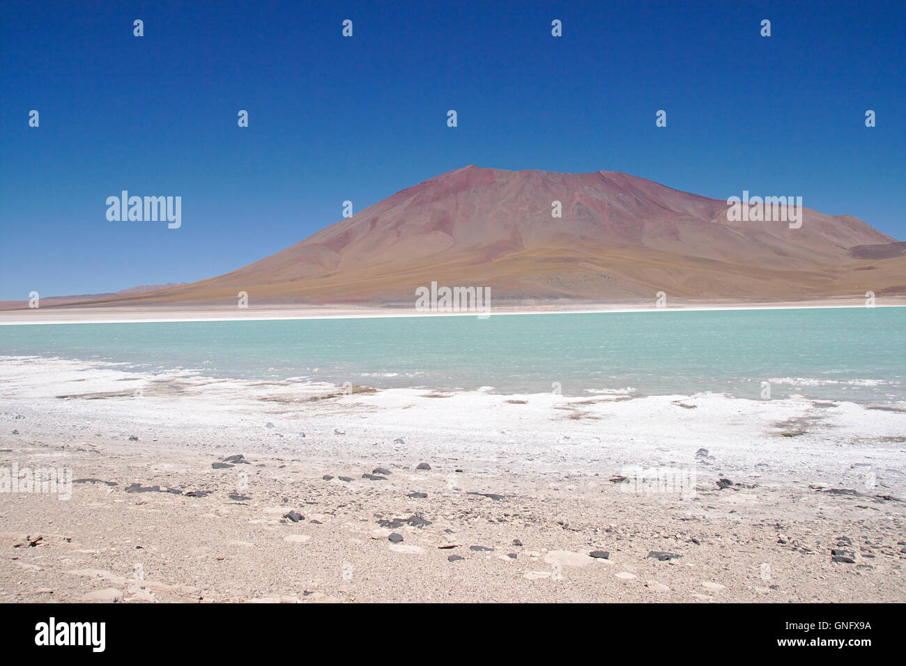 Laguna Verde (Green Lake) with salt playa and Juriques volcano, Bolivia - Stock Image