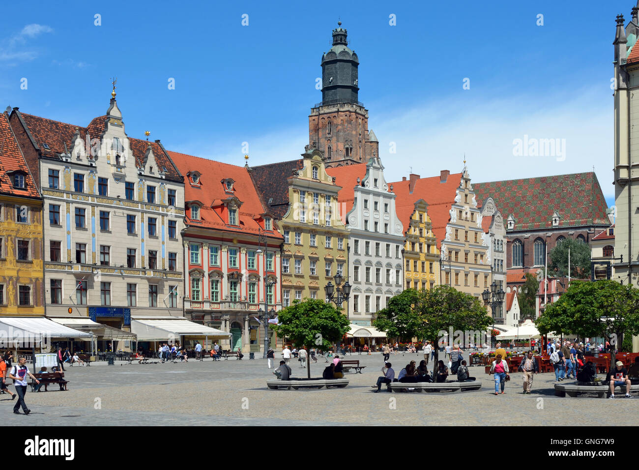 Pedestrian of the Market Square in the historical Old Town of Wroclaw with view of the St. Elizabeth's Church - Stock Photo