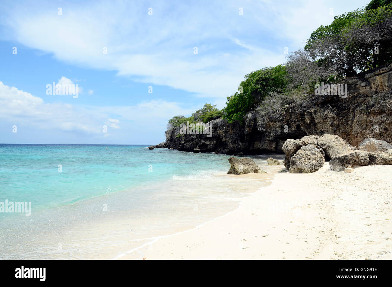 Blue water and white sand of Beach in Curacao island, Caribbean Sea - Stock Image