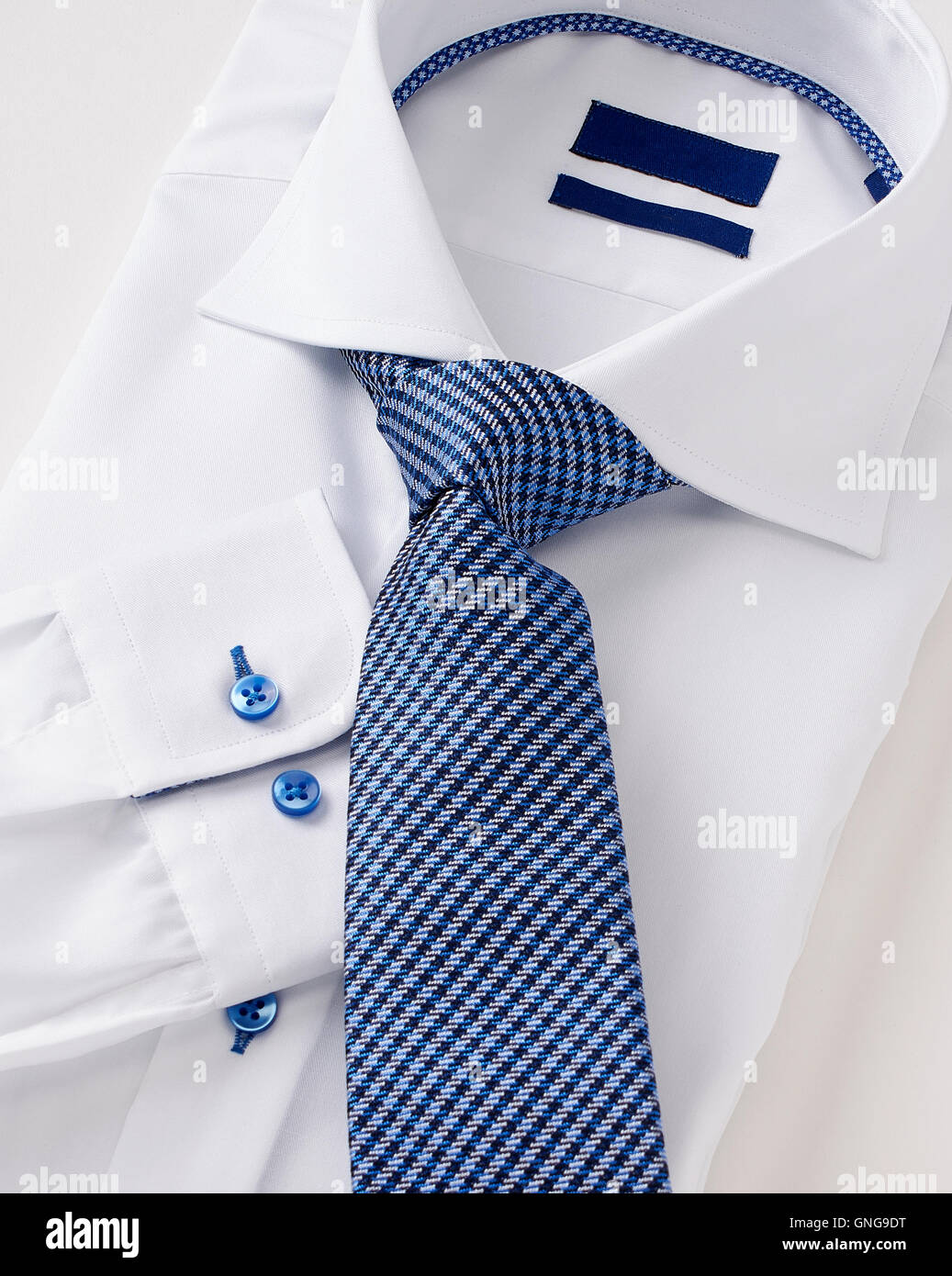 men shirt clothing with tie on white. - Stock Image