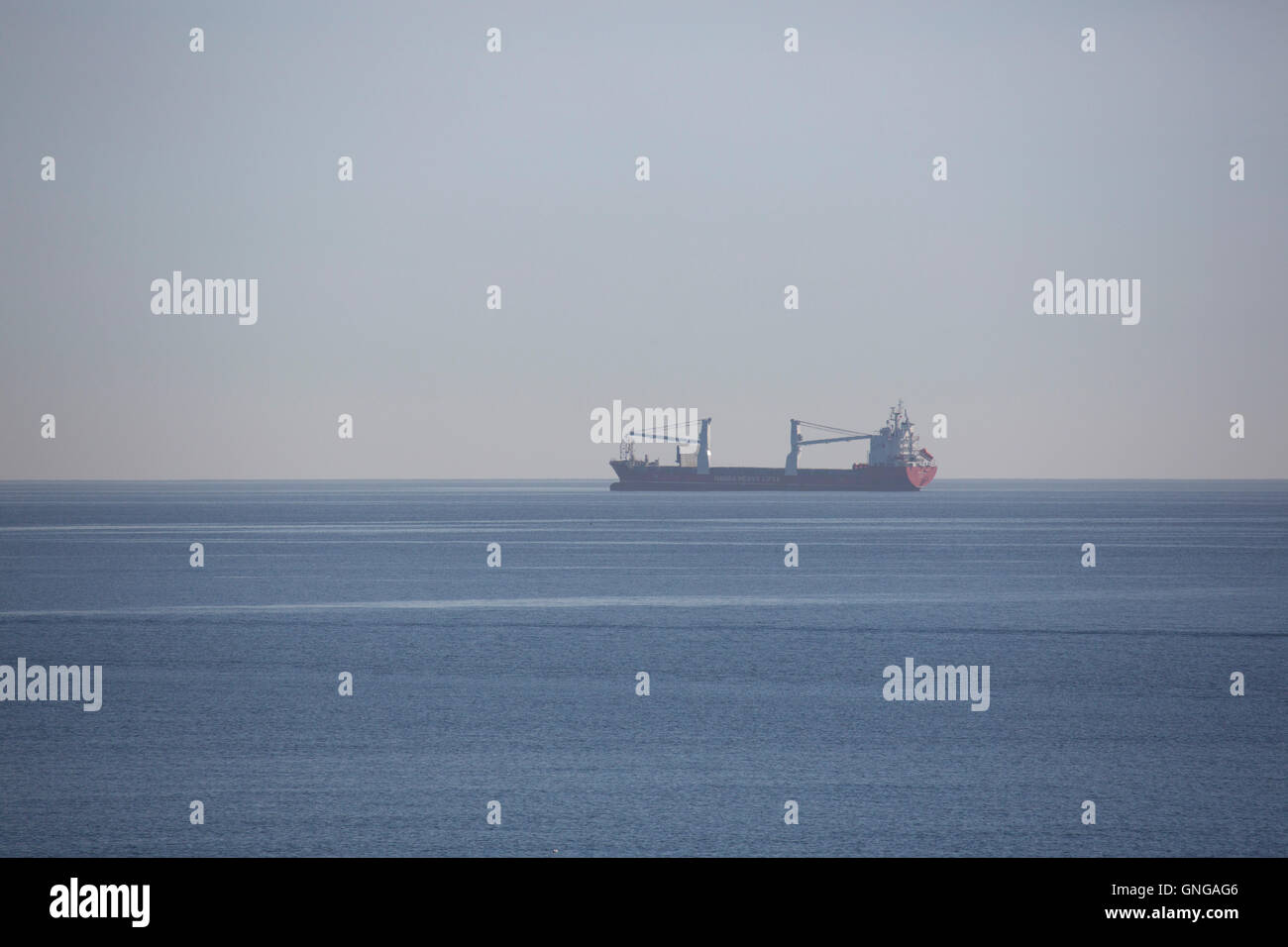A Hansa Heavy Lift ship offshore during the weekend of the North Sea Tall Ships Regatta at Blyth in Northumberland, - Stock Image