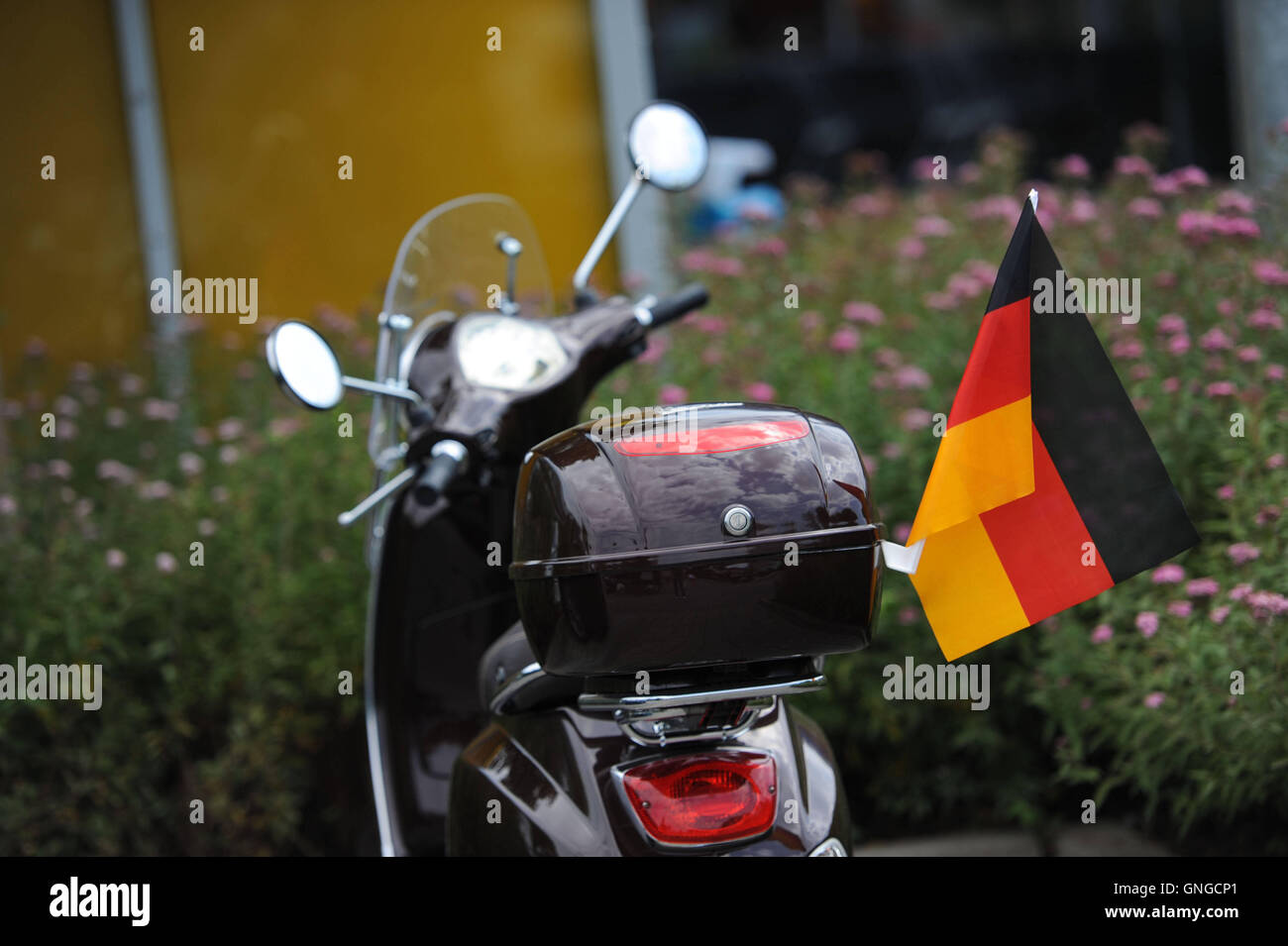 Flagged Vespa scooter in Munich, 2014 Stock Photo