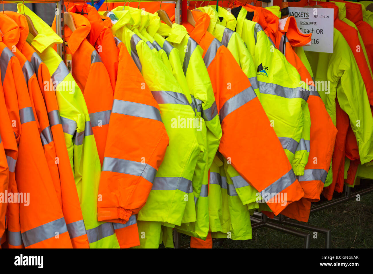 hi visibility jackets for sale on stall at Great Dorset Steam Fair, Tarrant Hinton, Blandford, Dorset in August Stock Photo