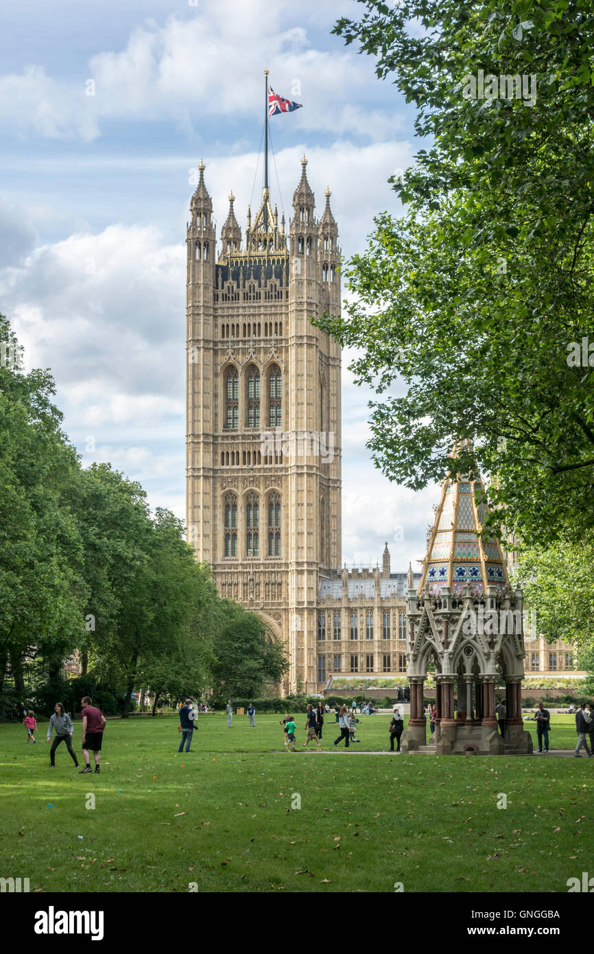 Victoria Tower Gardens with Buxton Memorial Fountain and Victoria Tower, Houses of Parliament. London, UK - Stock Image
