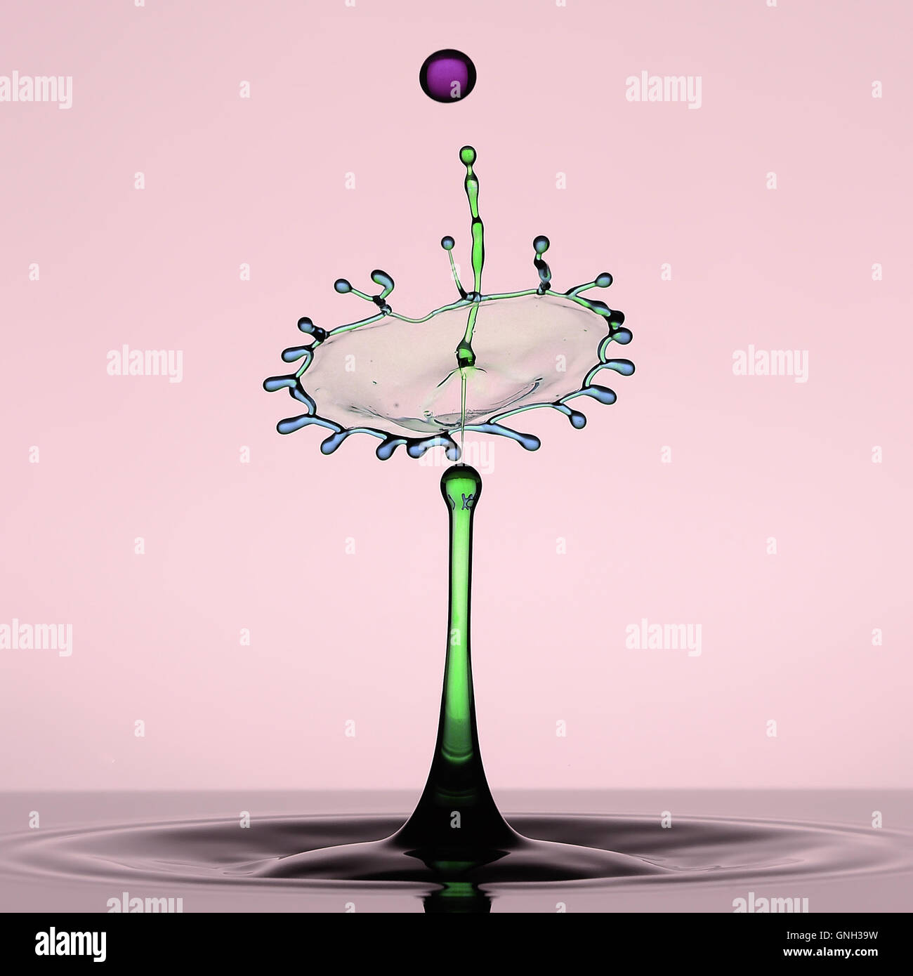 Multi-colored water droplet and splash crown - Stock Image